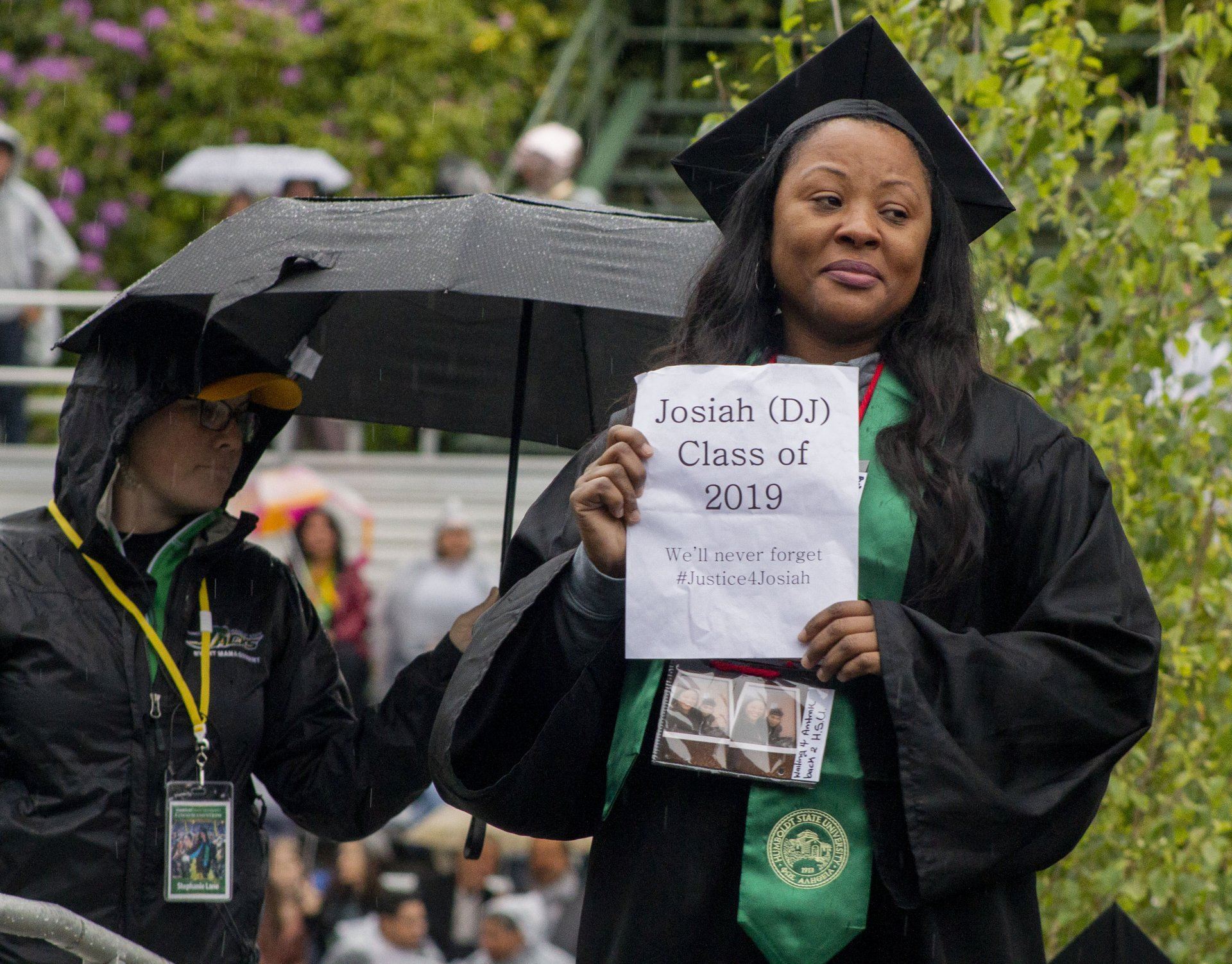Charmaine Lawson stands on stage as her son's name is read at the Humboldt State University 2019 commencement on May 18, 2019., as Josiah is awarded a degree posthumously two years after his death off campus. | Photo by Thomas Lal