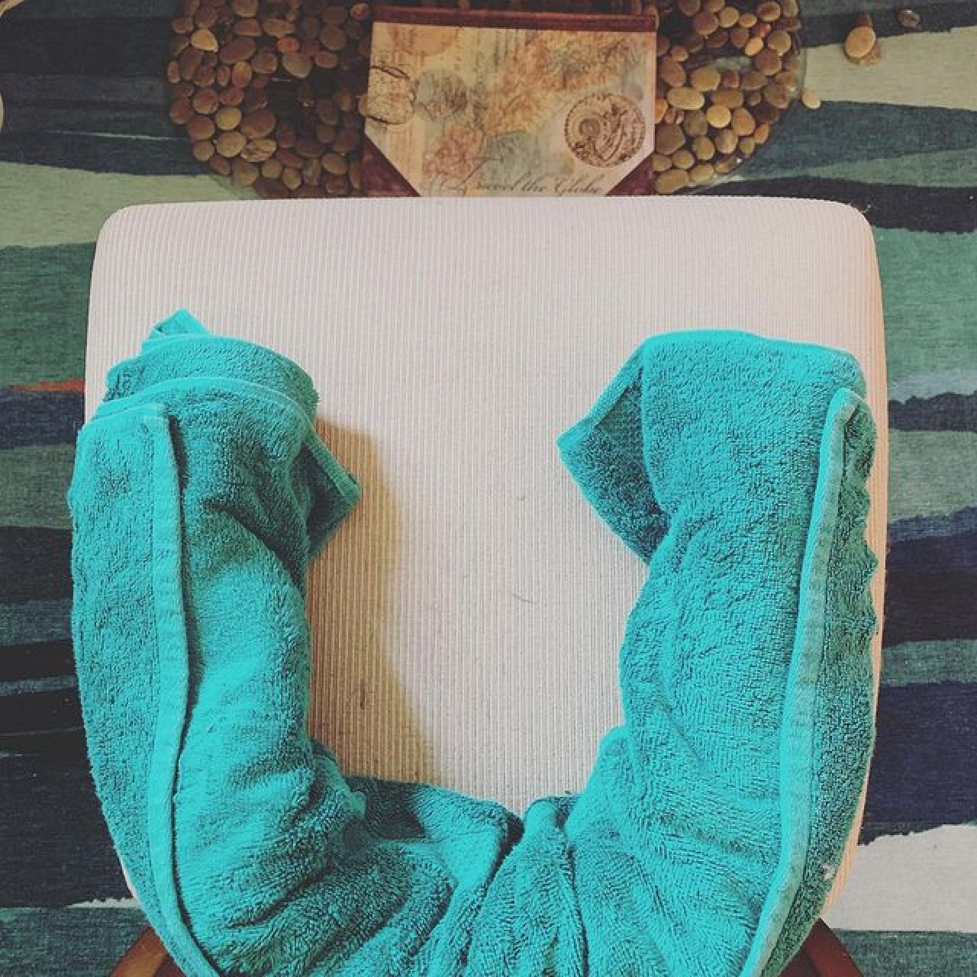 Desk chair life hack! Take a towel, fold it in half, roll it, mold it into a C and sit on it! It'll help to hold your pelvis in place so you will end up having better posture for when you're sitting. | Photo courtesy of Whitney Ogle