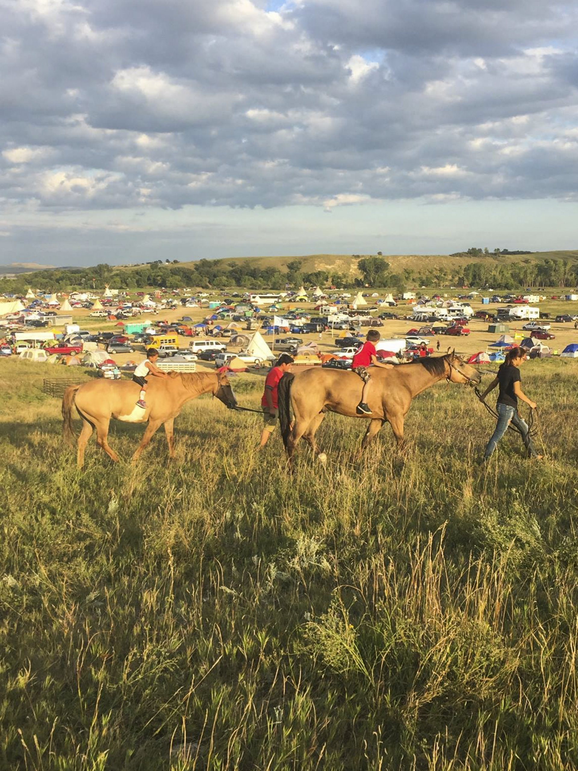 Two children on horseback outside of the Standing Rock camp last year. | Connor Hadley