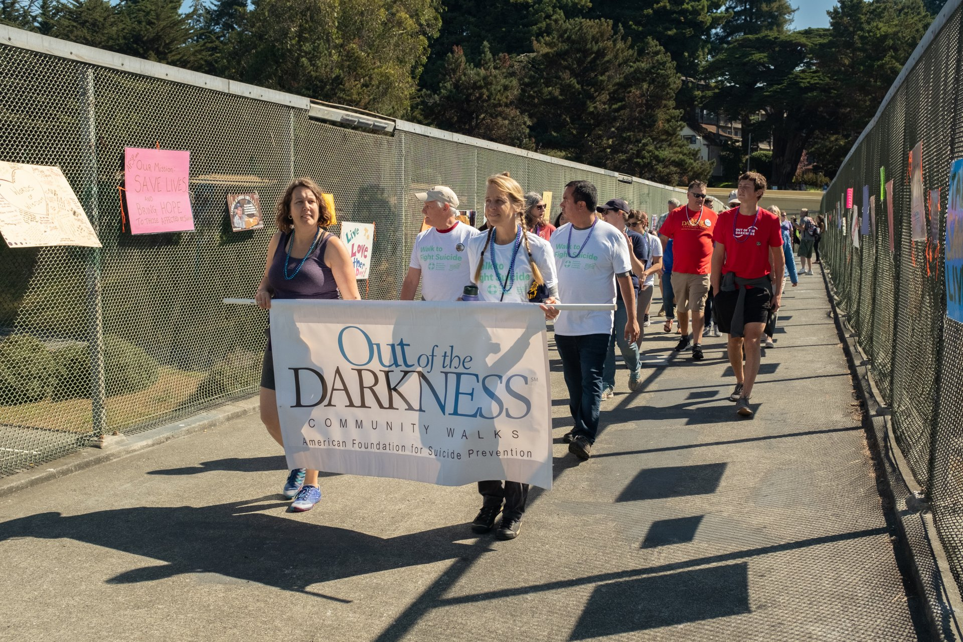 """(Photo by Michael Weber) Participants make their way to the """"bridge of support"""" during the Out of the Darkness community walk in Arcata, CA on Sept. 9."""