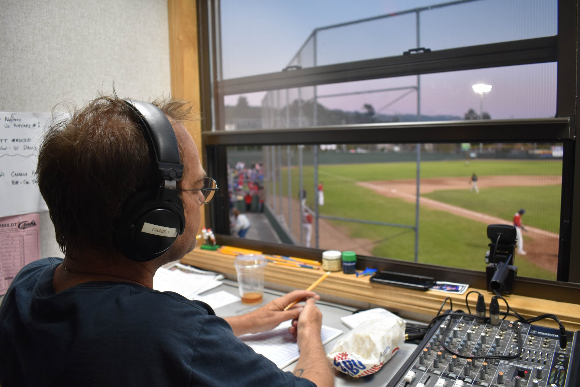 Benjamin Shaeffer looks out onto the field as he calls the Crabs game up in the booth. | Photo by Liam Warner
