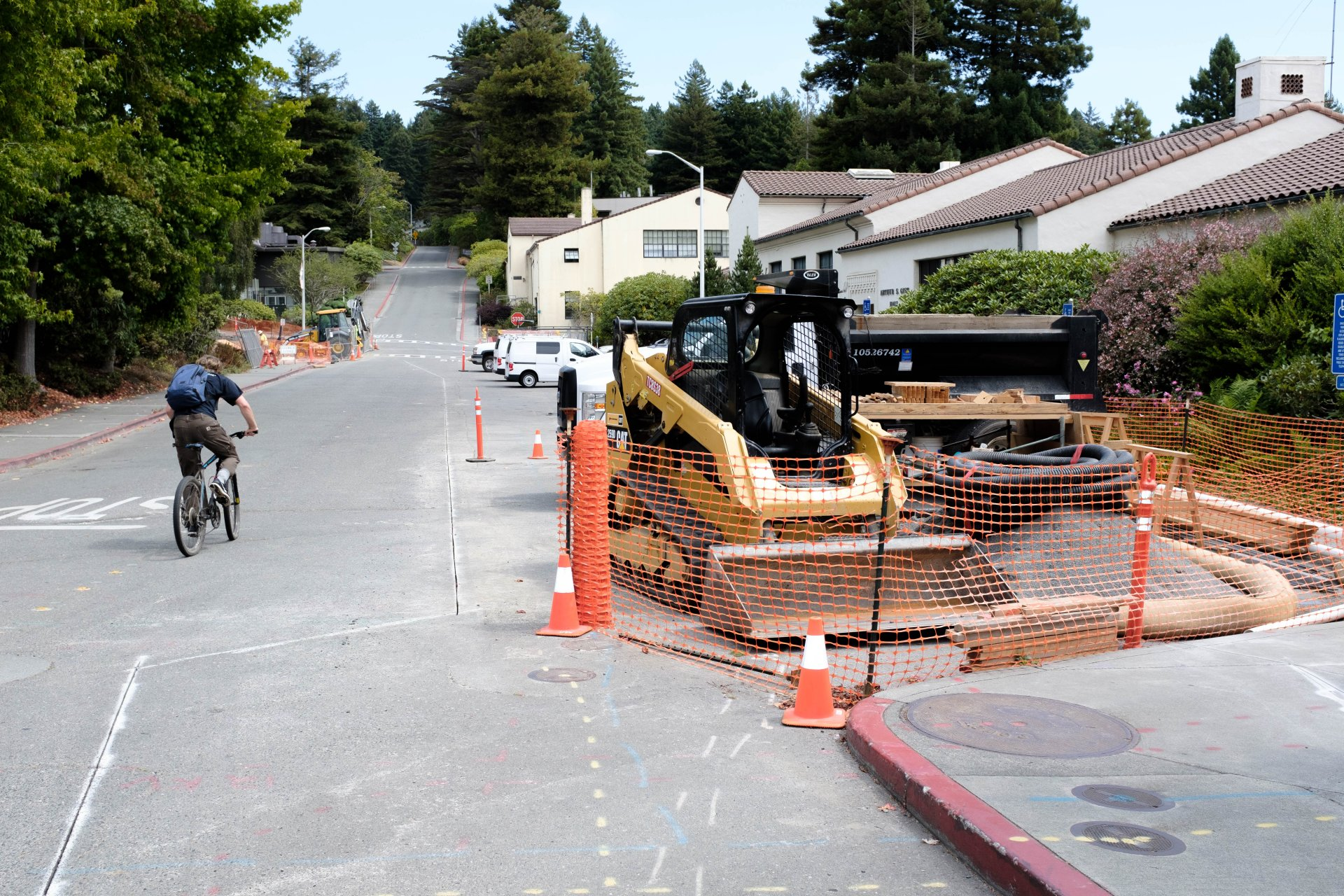 Machinery parked on marked walkways on Laurel Drive on August 20. Construction is due to start this semester for a new handicap parking lot. | Photo by Michael Weber