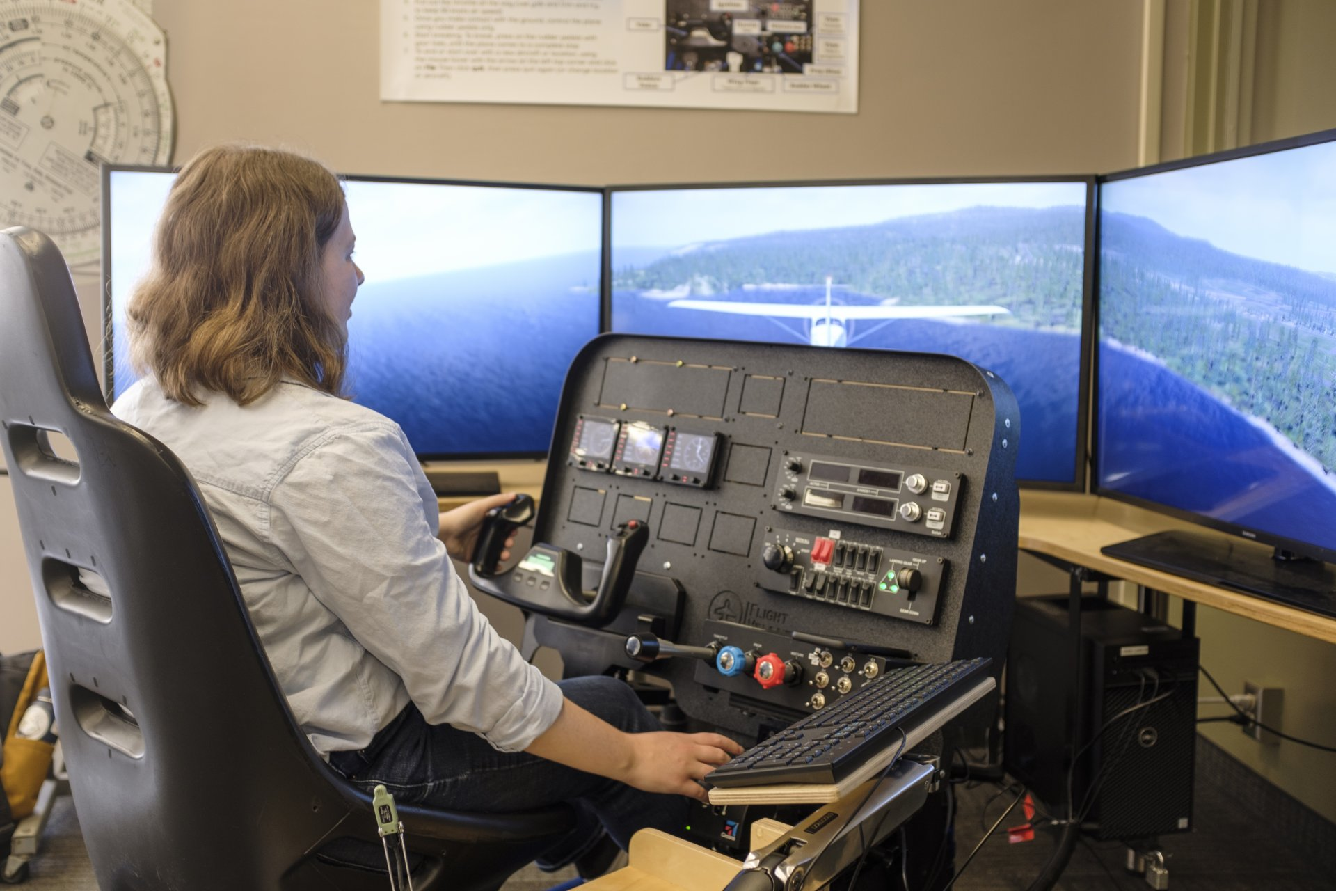 President of the PC Gaming Club Sarah Livingstone flies over Trinidad Head in a simulated flight on Sept. 12. The simulator software is customizable to most airports. | Photo by Michael Weber