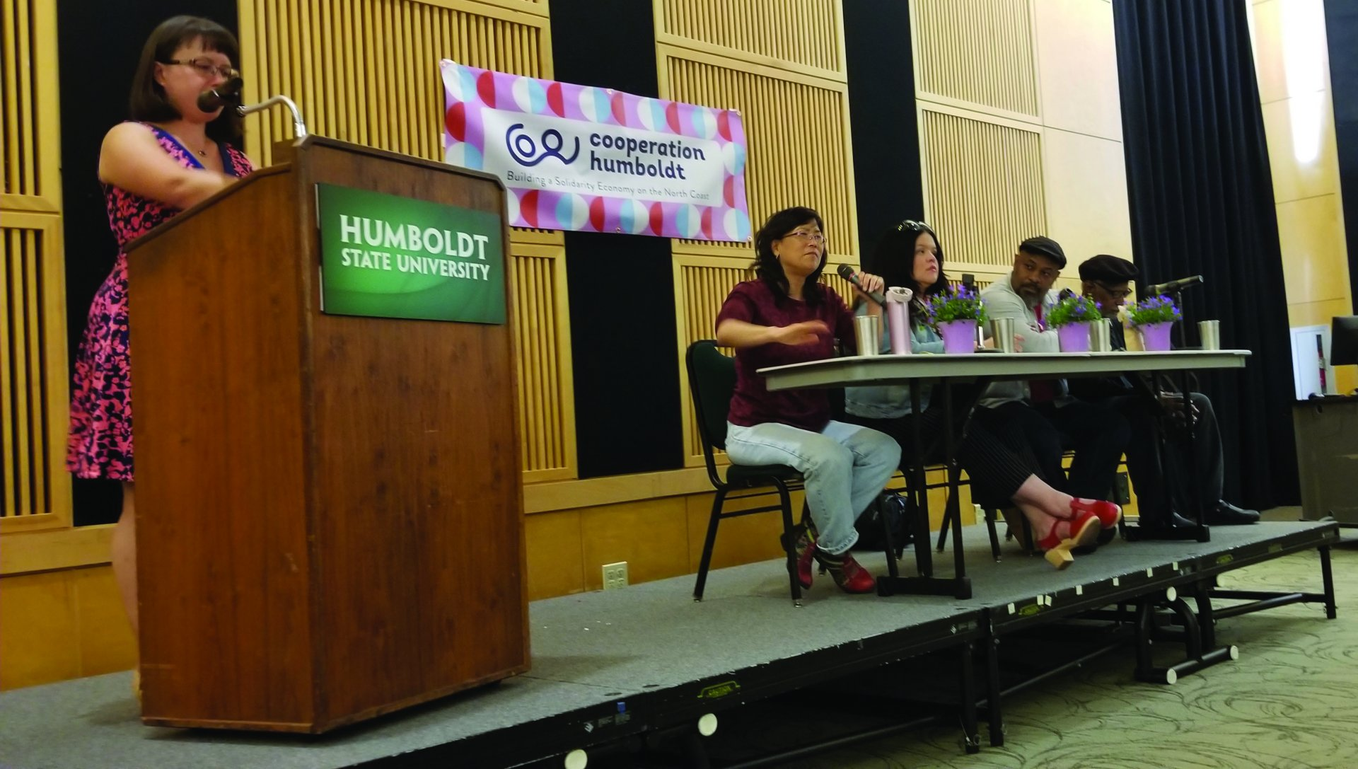 From left to right, Tamera Mcfarland, Emily Kawano, Cutcha Risling Baldy, Kali Akuno, and Jarome Scott on stage at the night of Cooperation Humboldt. | Photo by Luis Lopez