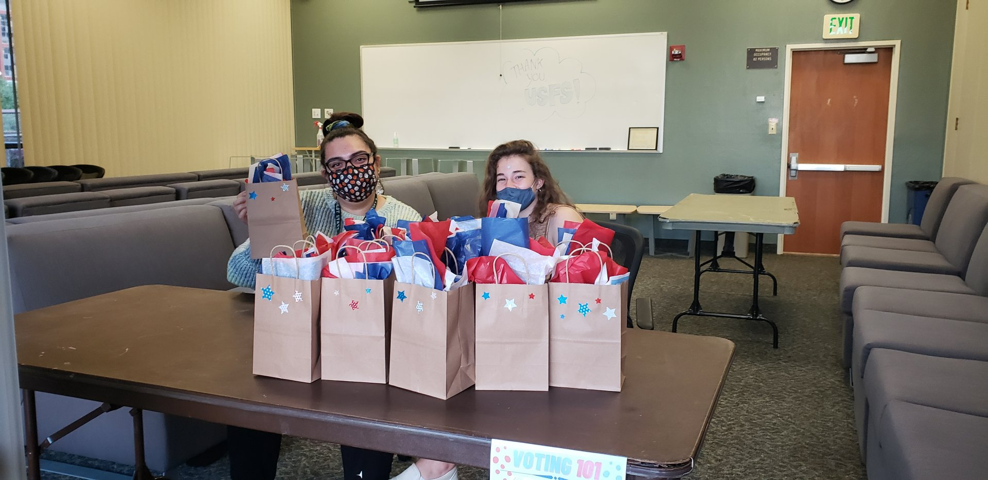 SA's Sam Mariscal and Madi Kiser hosting an event in voting and giving out goodie bags to residents on Oct. 16 | Photo by Seth Finnegan