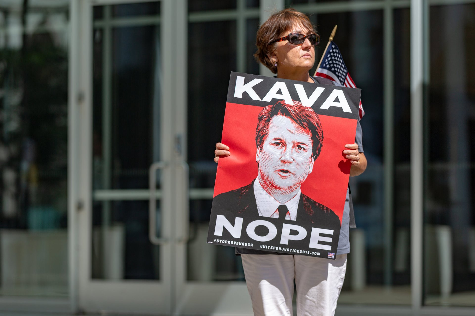 A protester against the confirmation of U.S. Supreme Court nominee Brett Kavanaugh outside the Warren E. Burger Federal Building in St. Paul, Minnesota. | Photo courtesy of Lorie Shaull