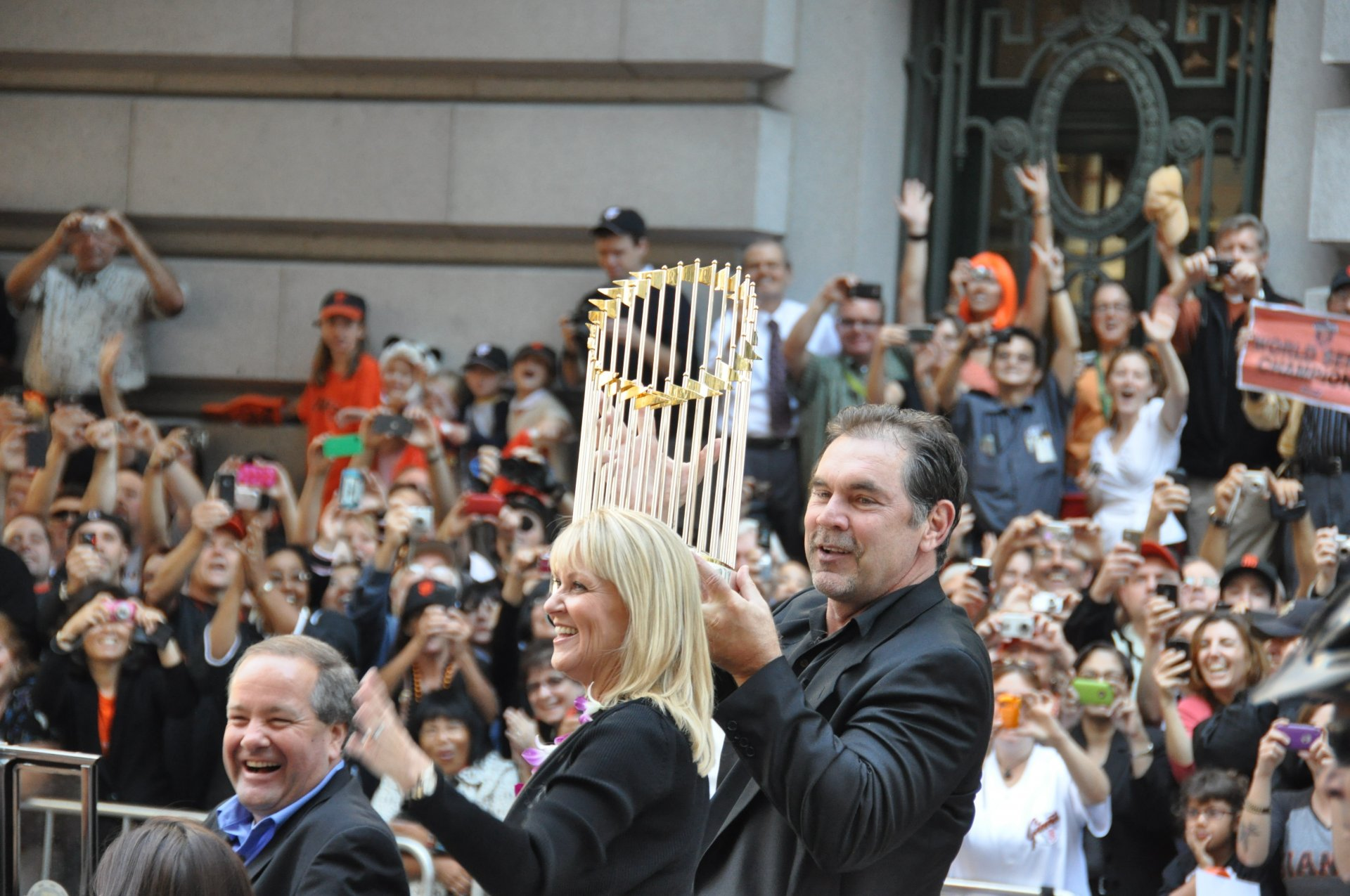 Bruce Bochy holding up the Commissioner's Trophy after the Giants' 2010 World Series win. | Photo by Mike Deerkoski