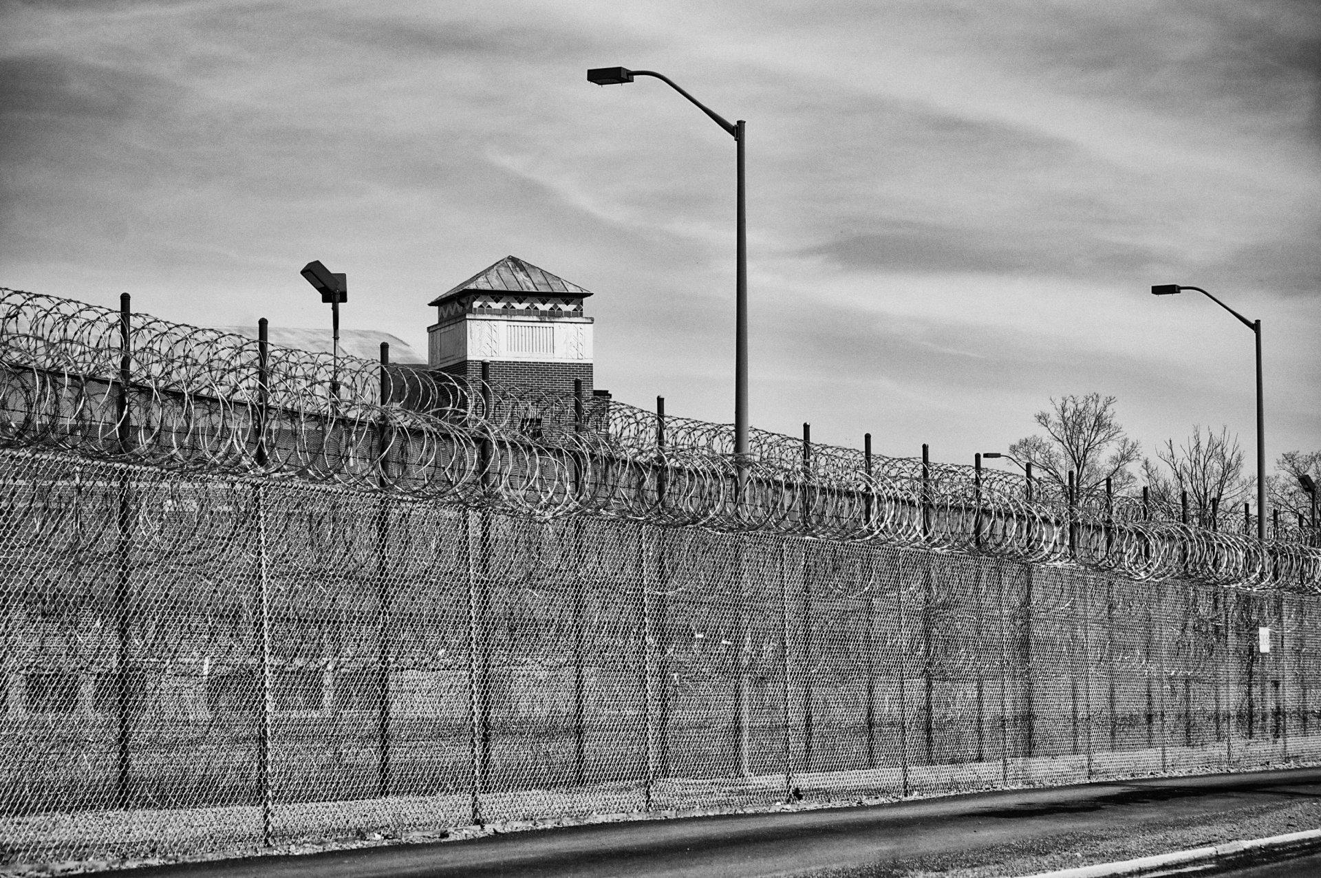 Prison fence in black and white.   Photo courtesy Brad Kozlek