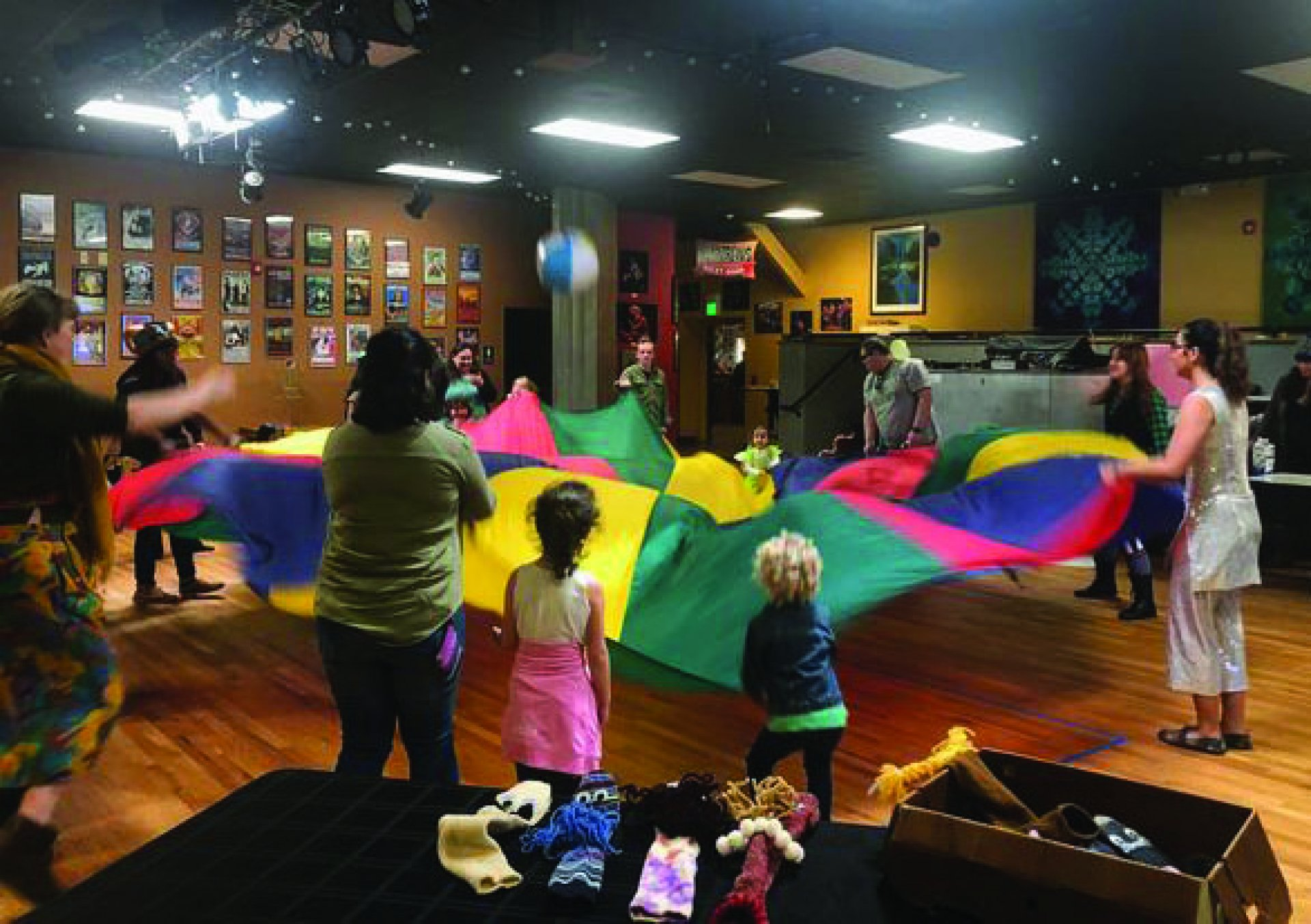 Gathering around to play games with a giant parachute was just one of the many activities the Humboldt Circus offered to the kids. March 17. | Photo by Skylar Gaven