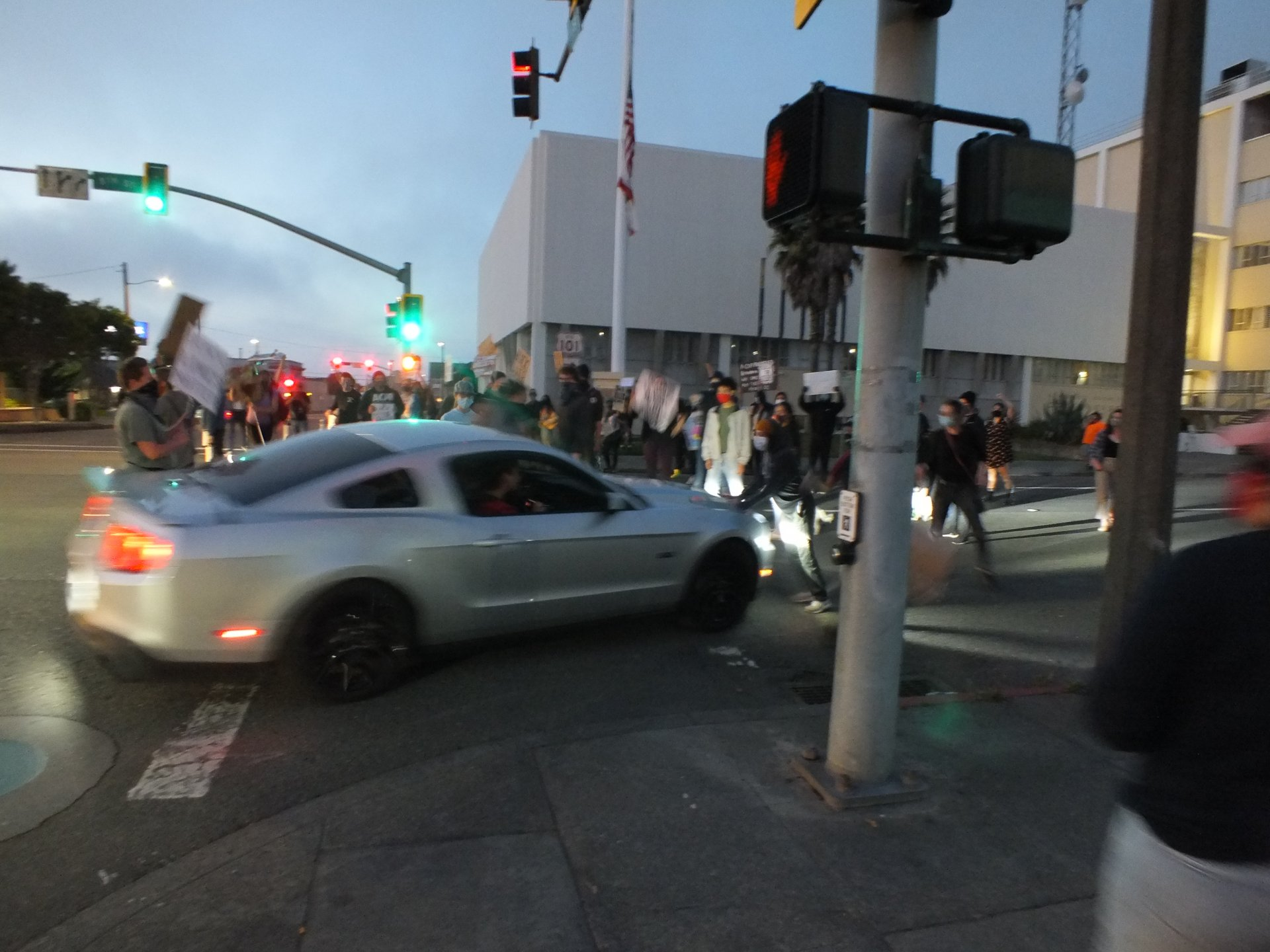 A car begins to drive through the blockade of protestors near the Humboldt County Court on Sept. 24. While this instance would leave protestors relatively uninjured, a later collision would leave one protestor injured and taken to the hospital.   Photo by Carlos Holguin