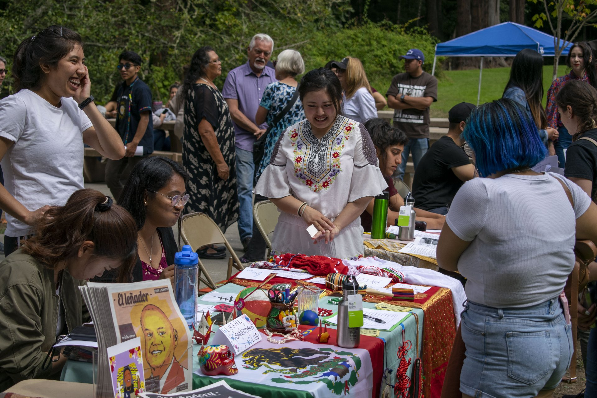 A table at the Convivio de Bienvenida, a Convivial Welcome from HSU's El Centro Académico Cultural on Sept. 15. The event, held at Arcata's Redwood  Park, housed tables for resources at HSU and the surrounding community. | Photo by James Wilde.