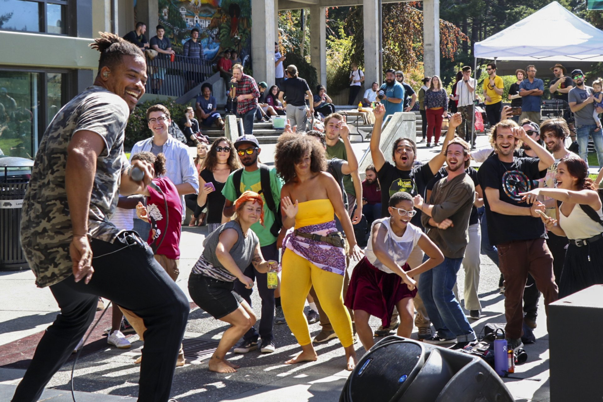File photo: Baba Zumbi, also known as MC Zion, dances with Humboldt State students during Zion I's performance in the UC quad on Sept. 26, 2017. | Photo b Curran C. Daly