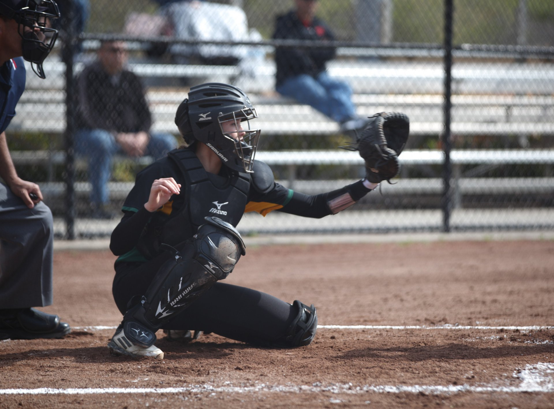 Freshman catcher Micaela Harris sets up for the incoming pitch. The Jacks dropped the doubleheader against Cal State East Bay on March 18 to split the four-game series over the weekend. Photo by Stephen Ellis.