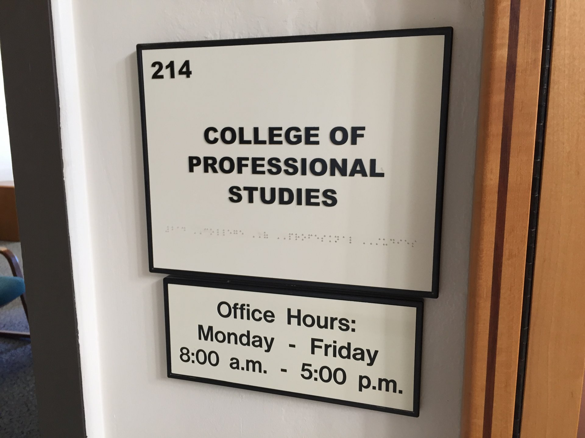 The College of Professional Studies sign outside of Gist Hall 214. | Photo by Iridian Casarez