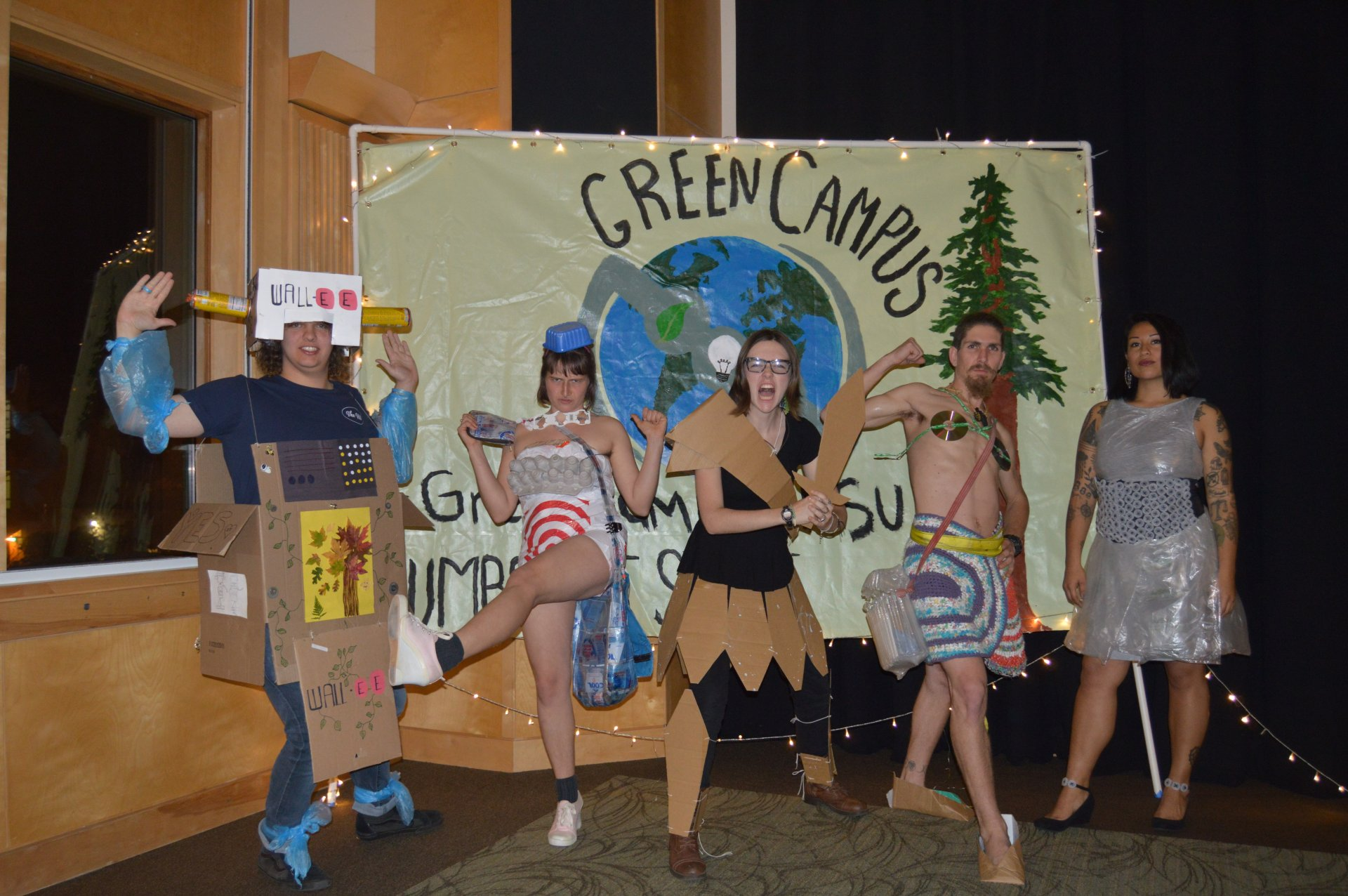 The competitors in the Green Campus Trashion Show strike an action pose right after they walked across stage. The Trashion Show intended to raise awareness about trash and display alternative uses for common products. | Photo by Collin Slavey