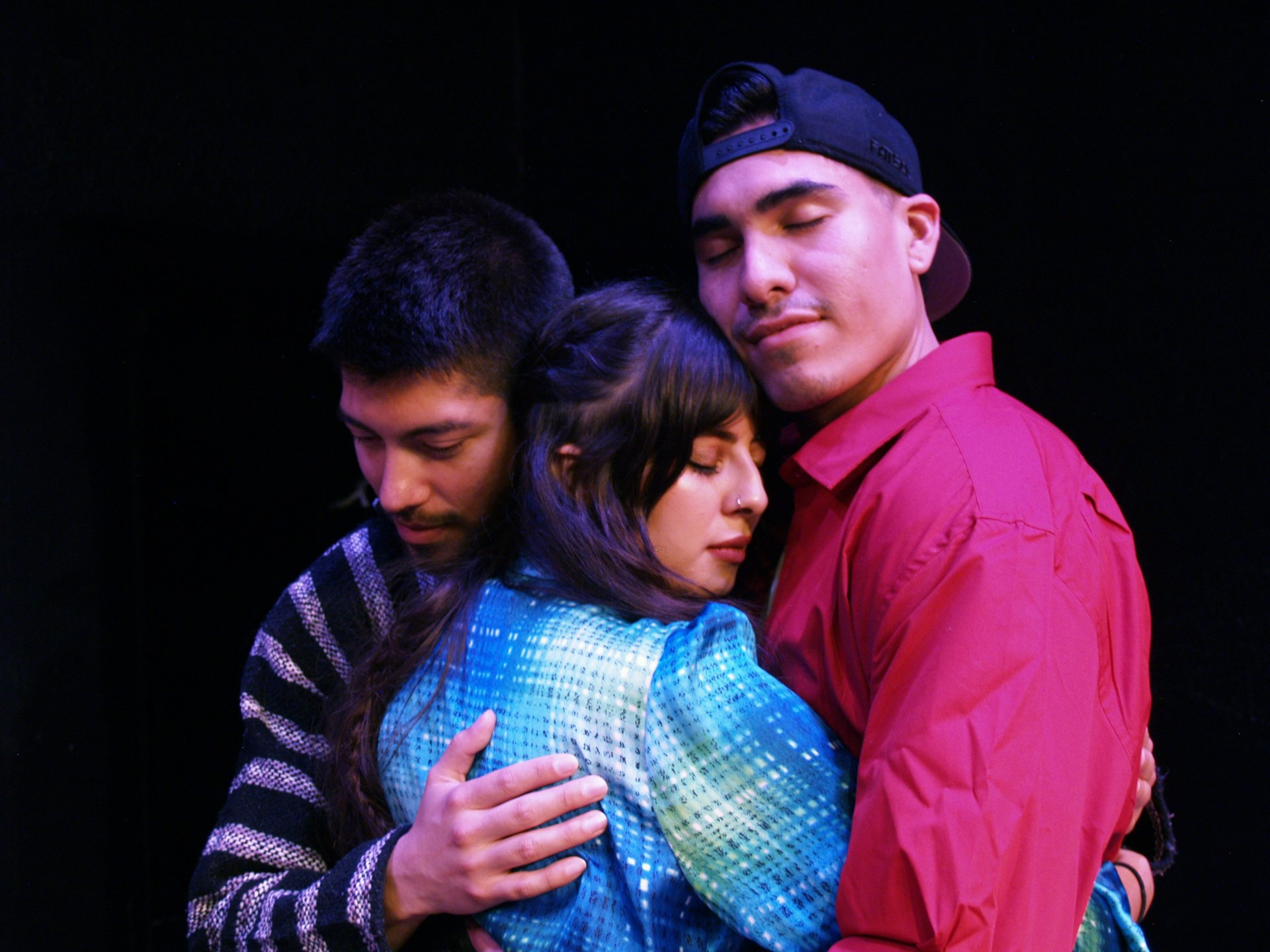 Alejandro Torres as Francisco, Wendy Carranza as Ximena and Victor Parra as Mateo embrace during the final rehearsal of