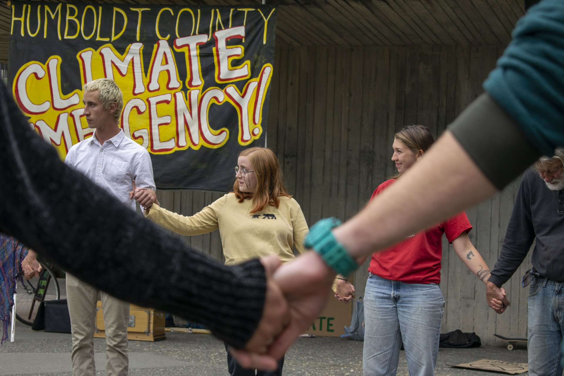 Olivia Brock, HSU wildlife biology major and indigenous peoples natural resource use and the environment minor, speaks after a die-in climate protest in HSU's quad on Sept. 27. | Photo by James Wilde