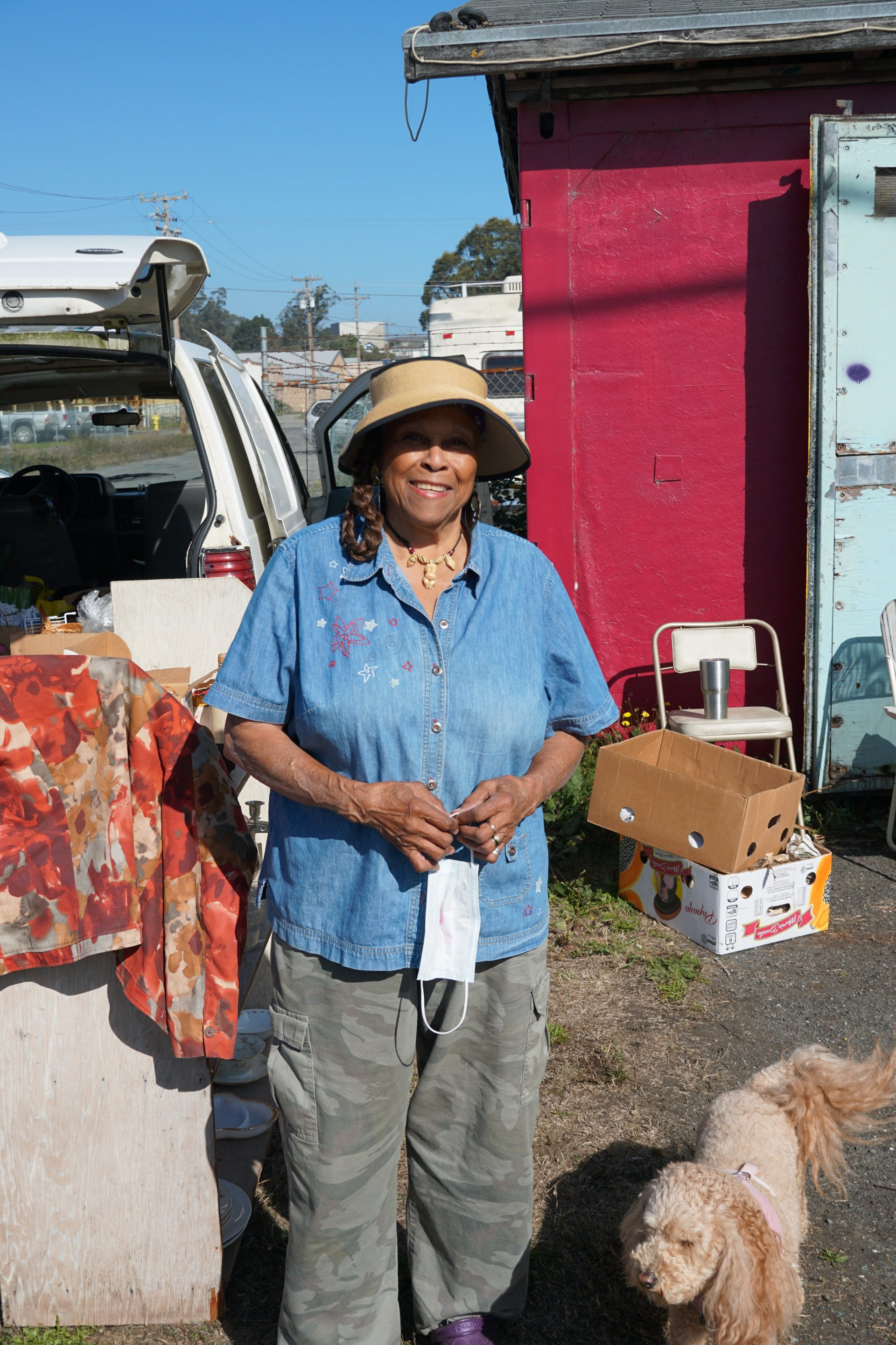 Marie Janisse-Wilkins stands with her dog Gris-Gris at a yard sale of her belongings in Arcata | Photo by Shawn Leon