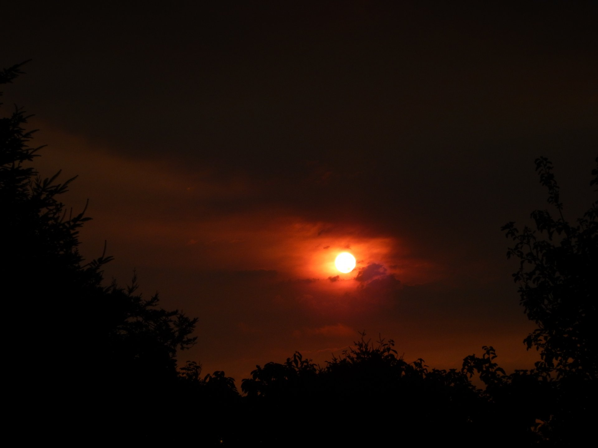 Smoke stains the sky over McKinleyville red at the start of fire season on Aug. 1, 2015   Photo by Mike Kelly