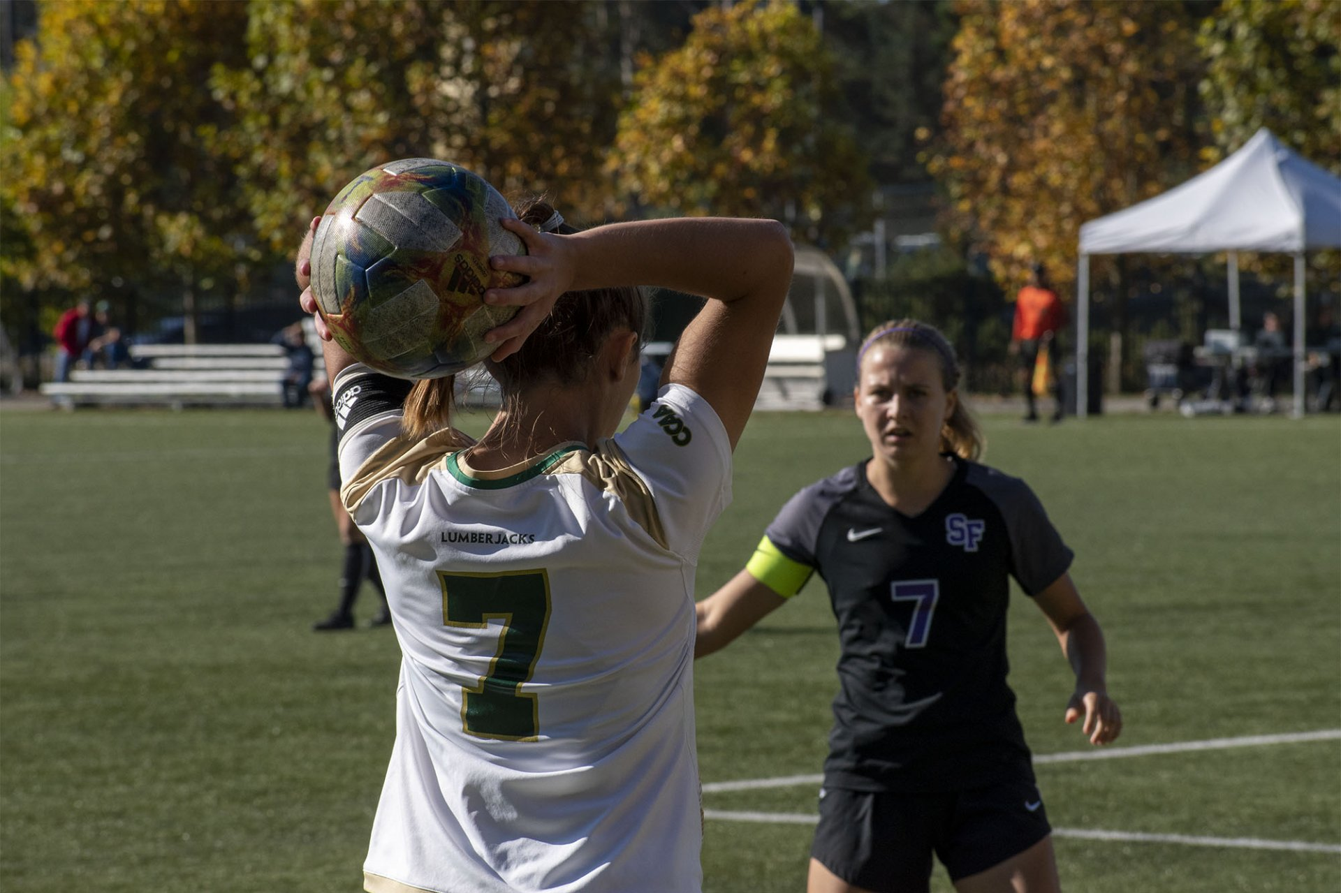 #7 Rose Harman takes the throw-in as Kylie Schneider watches. Humboldt State played San Francisco State at College Creek Field and won in overtime 1-0. | Photo by Liam Warner