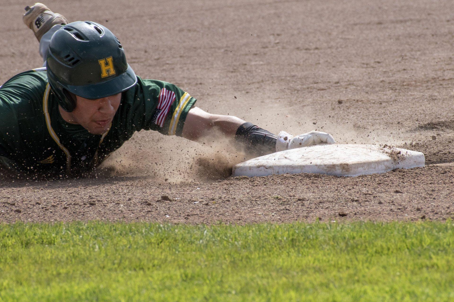 Jacks baserunner Alejandro Caravalho slides into third base during the HSU club baseball game on September 28th, 2019 at the Arcata Ball Park | Photo by Liam Warner