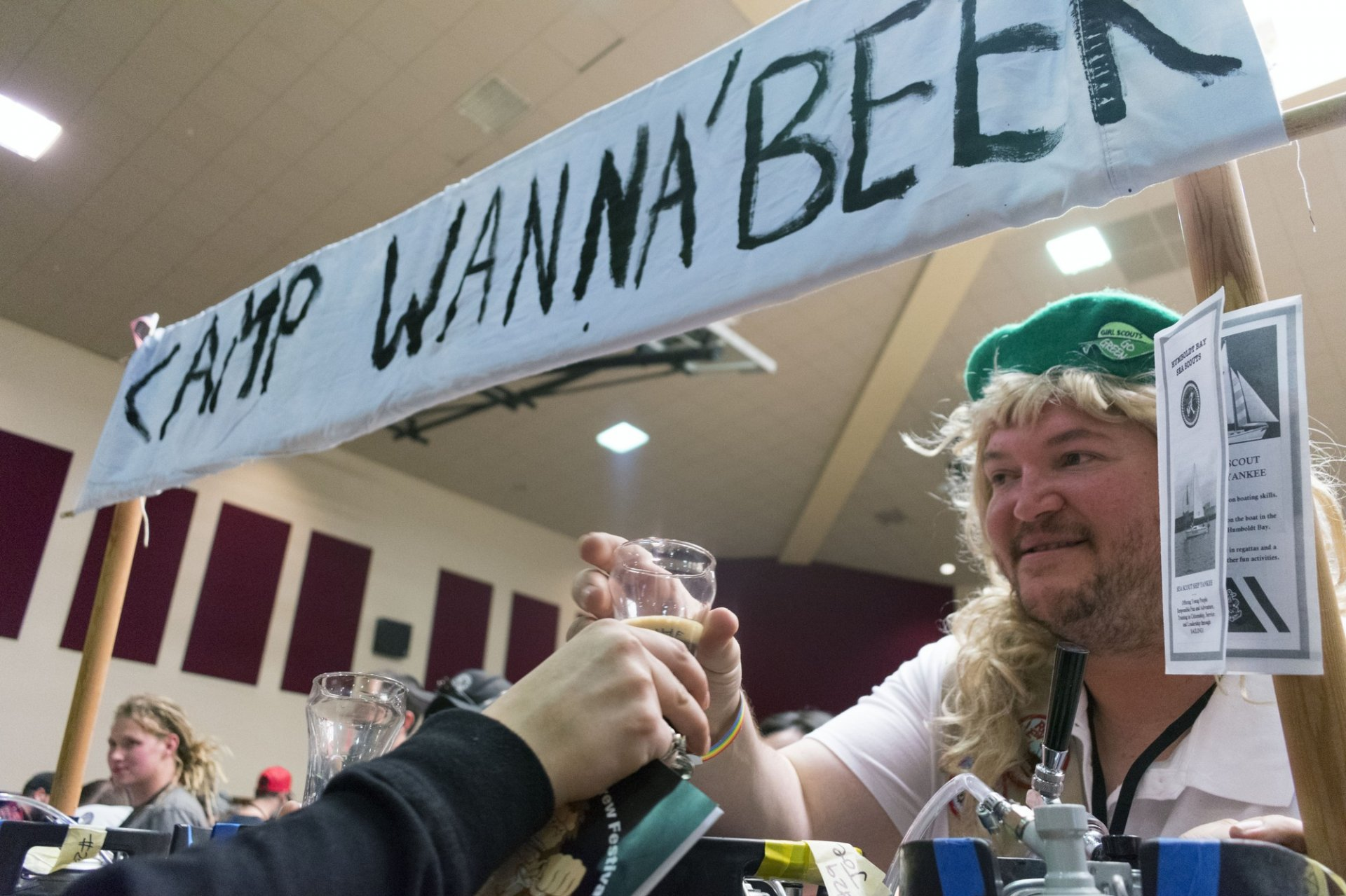 Brewer Joseph McKinzie, dressed as a girl scout, serves the Cookie Withdrawl Black IPA from the Camp WannaBeer booth at the 8th Annual Humboldt Homebrew Festival on April 7 at the Arcata Community Center. Photo by Megan Bender.