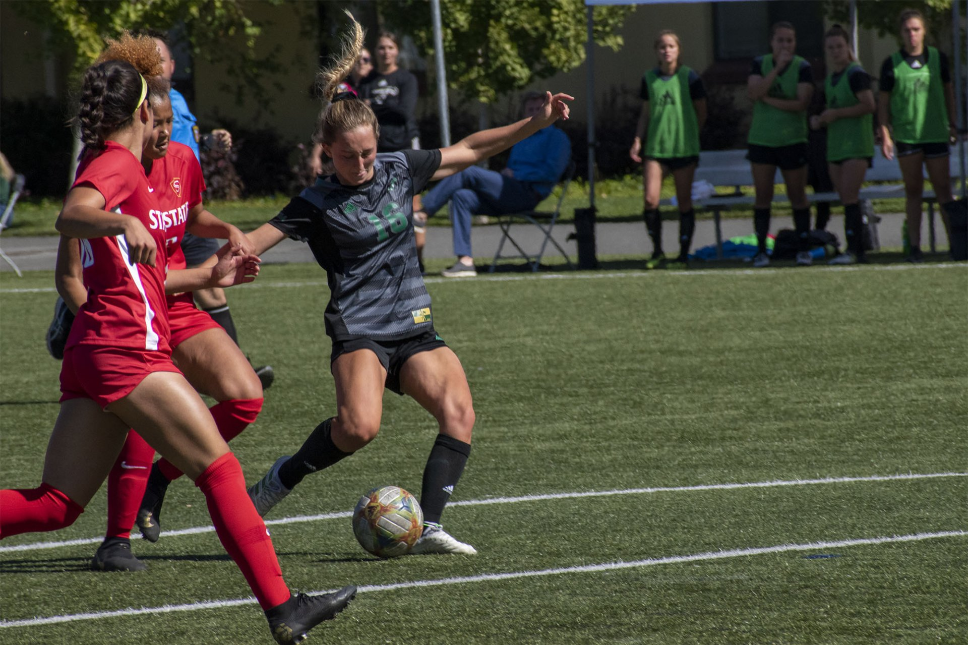Jacks midfielder #16 Sabine Postma gets off a shot while being draped by Warrior defenders. Humboldt State played Stanislaus State at College Creek Field in Arcata and lost 1-0 to the Warriors. | Photo by Liam Warner