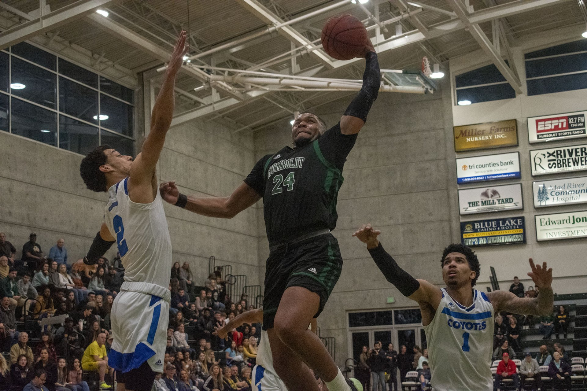 Rob Lewis, #24, prepares to unleash a ferocious dunk over Jeremy Smith, #2. HSU played Cal State San Bernardino and lost 94-72. | Photo by Liam Warner