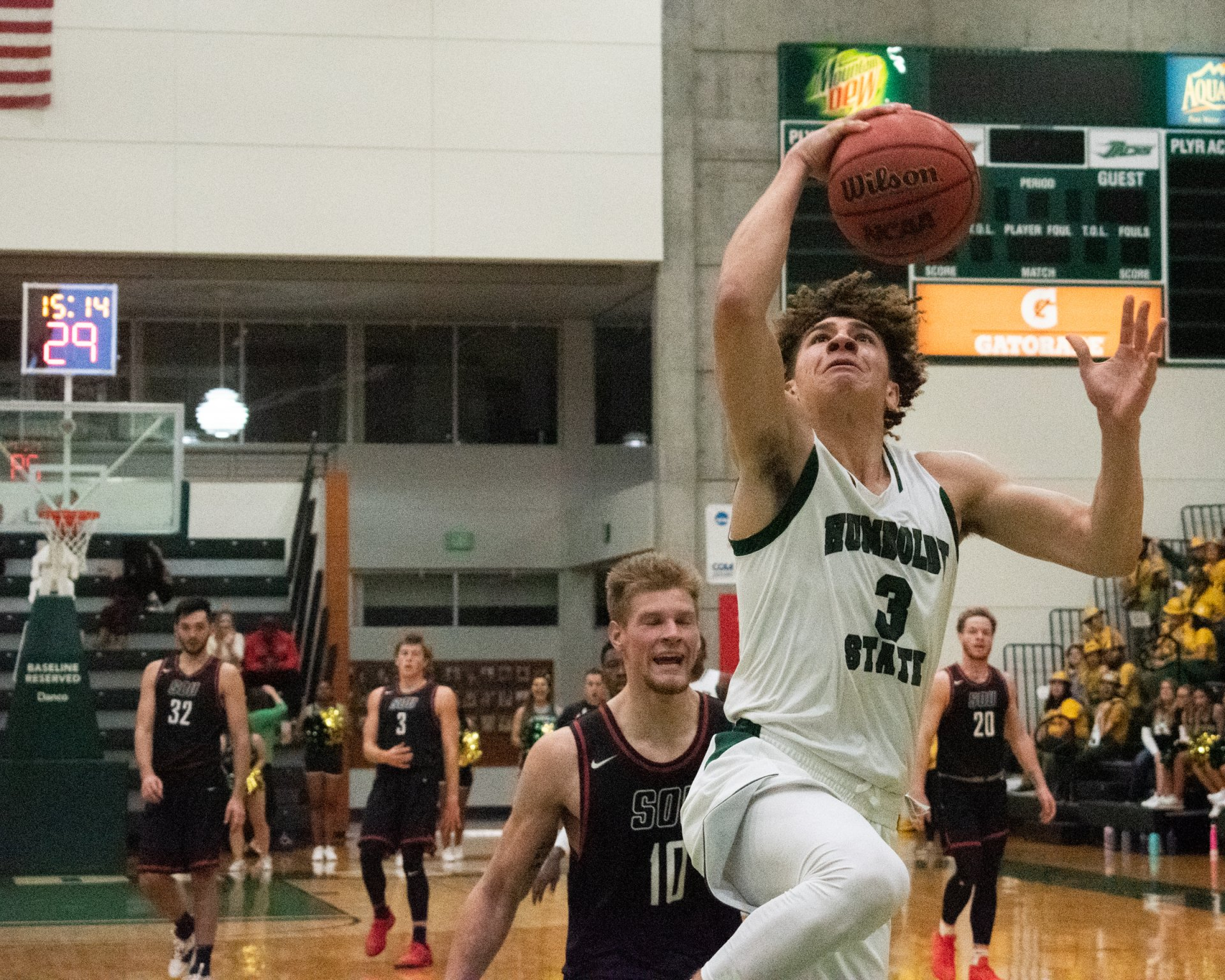 Humboldt State guard Isaiah Pope breaks away for a layup in Lumberjack Arena on Nov. 5.