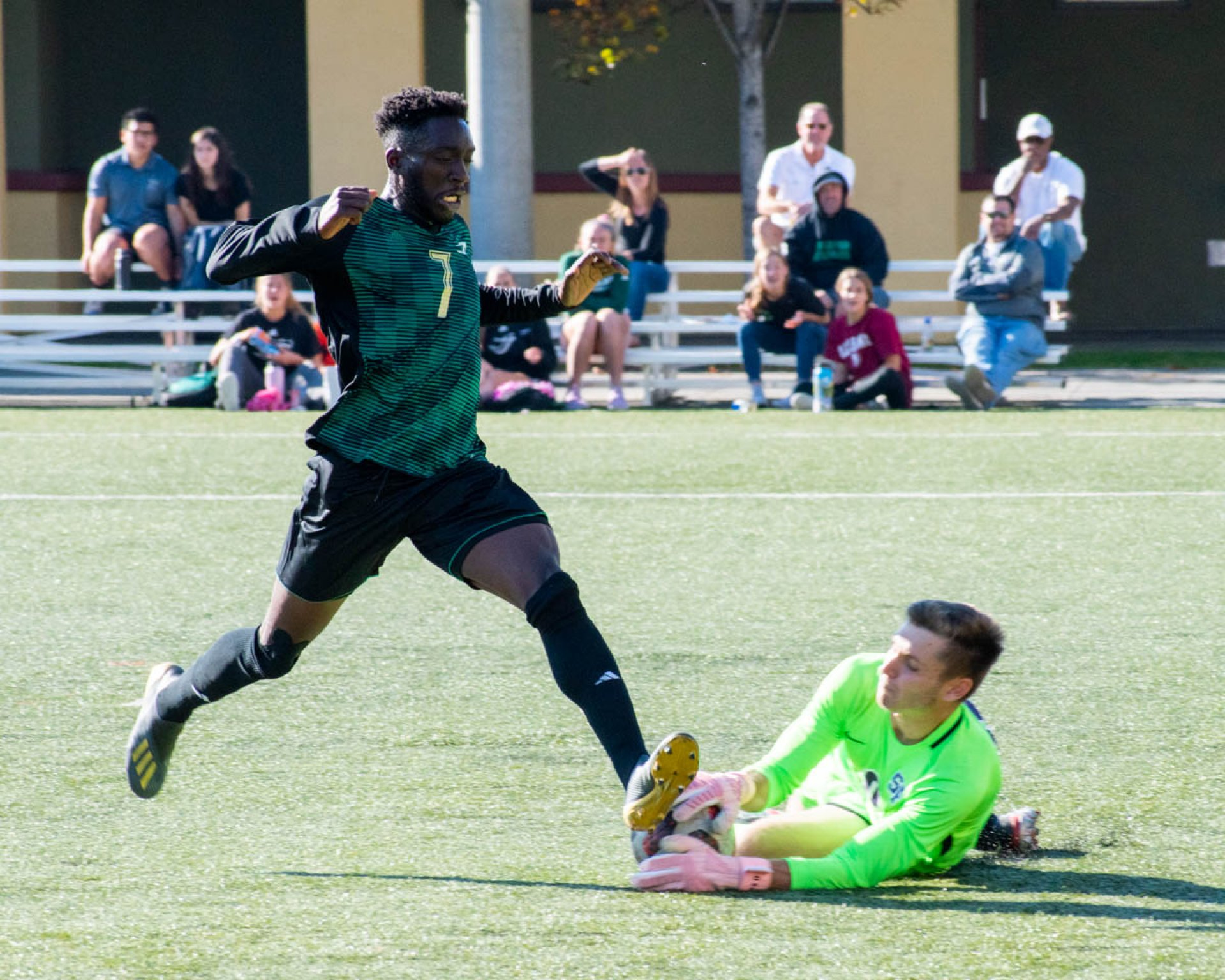Humboldt State forward Isaiah Dairo avoids a collision with San Fransisco State goalkeeper Peter Swinkels at the College Creek Field on Nov. 3.