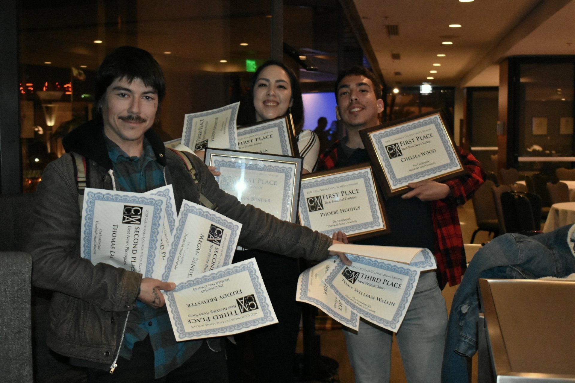 Humboldt State journalism students Tony Wallin, Megan Bender and Jose Herrera show off some of the awards won by HSU journalism students at the California College Media Association Excellence in Student Media awards banquet Feb. 29 in San Francisco. | Photo by Vanessa Flores