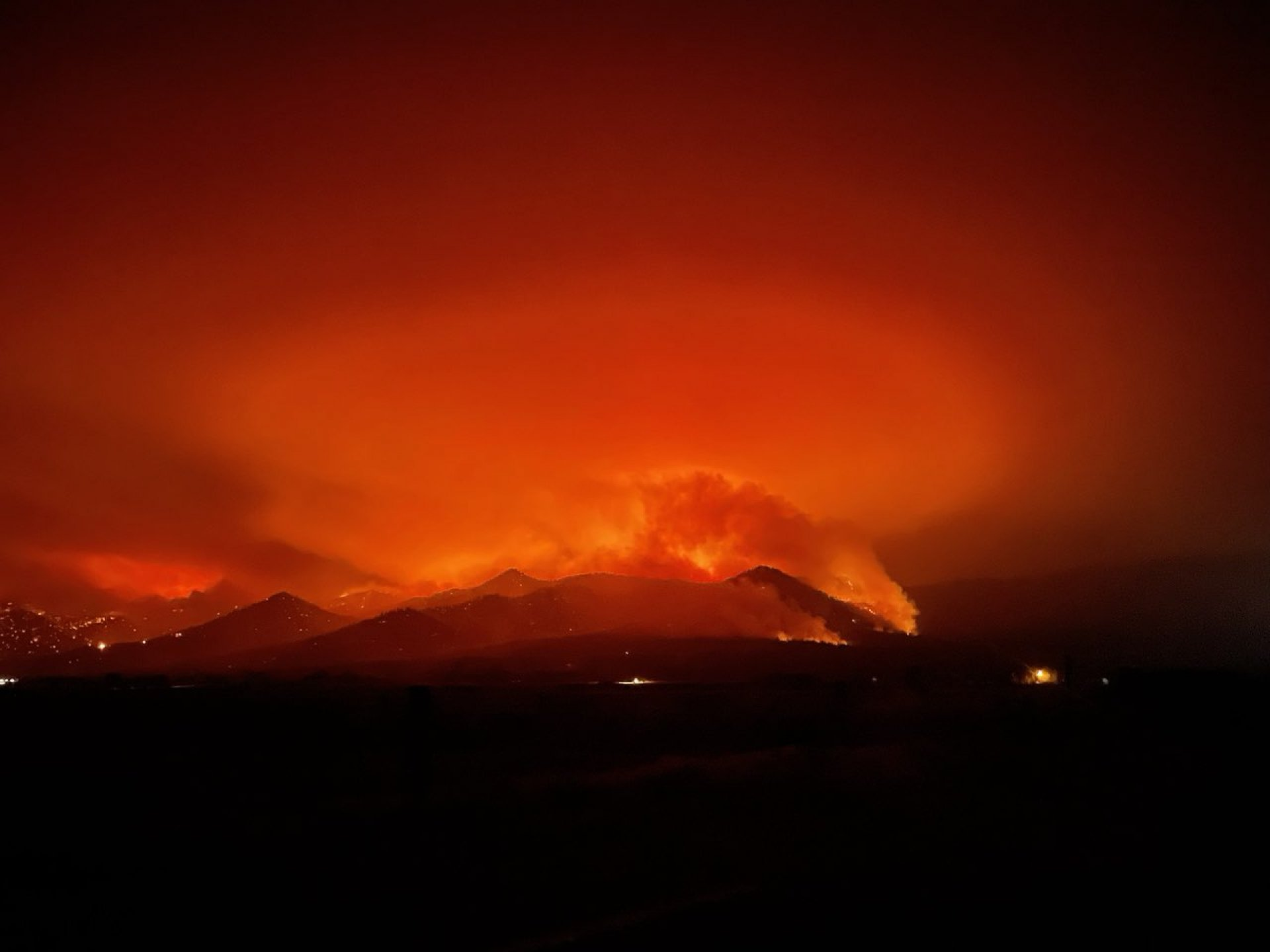 Trevor Albertson takes picture of Dixie Fire from LCC campus on Aug. 18.
