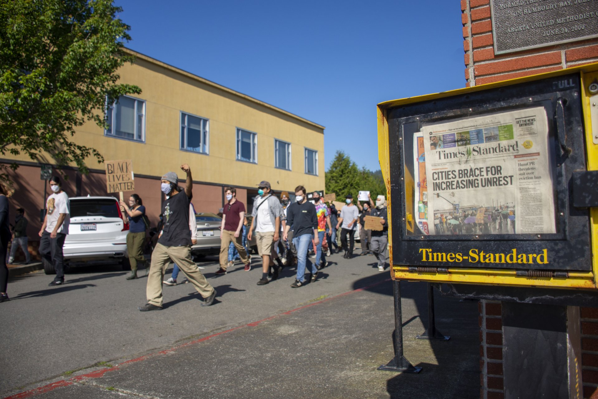 Protesters march towards the Arcata Plaza during a Black Lives Matter demonstration protesting the murder of George Floyd by a white police officer on Monday, June 1 in Arcata, CA. | Photo by Elliott Portillo