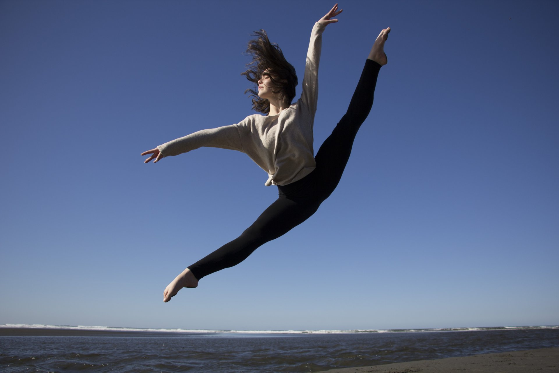 HSU student, Gabby Connors performs a Firebird on February 23 at Moonstone Beach.  Photo by Garrett Goodnight