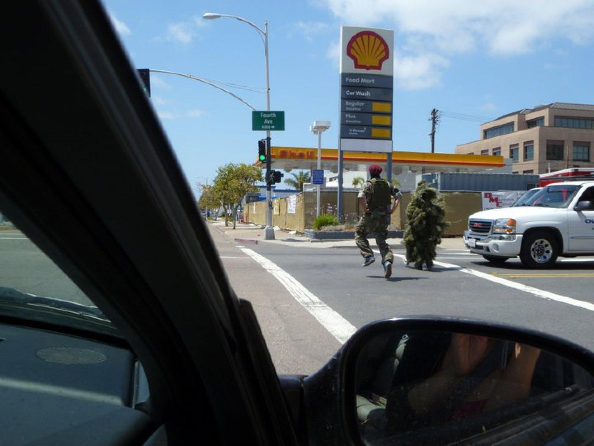 A person struts in a military uniform. | Phil Santos