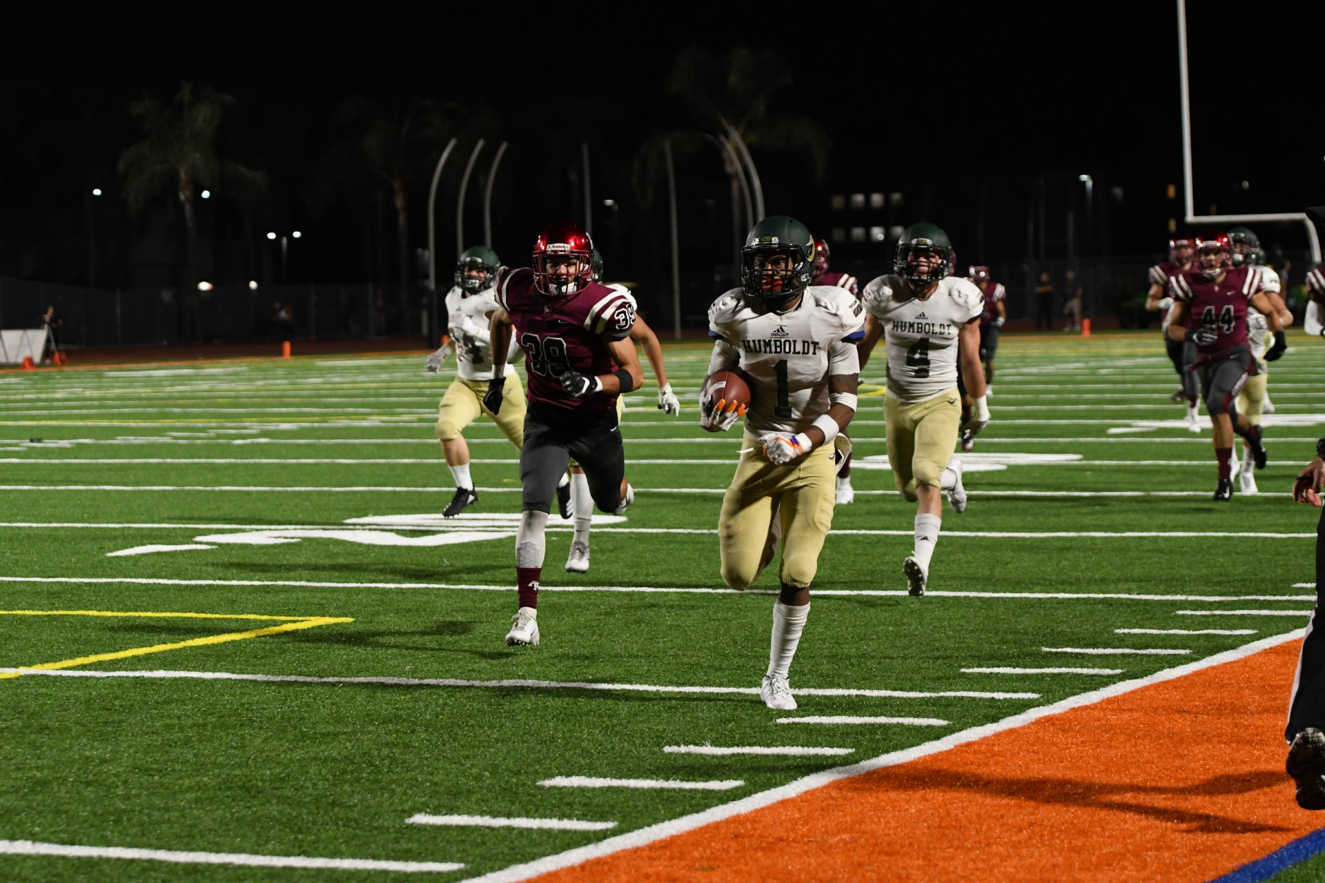 Jacks defensive back Ju'Wan Murphy returns the kickoff for a 85-yard touchdown as defensive back Adam Herrera trails to provide coverage. The Jacks lost to Azusa 37-21 on Sept. 29 at Citrus Stadium. | Photo courtesy of Asuza Media Technician: Holly Magnuson
