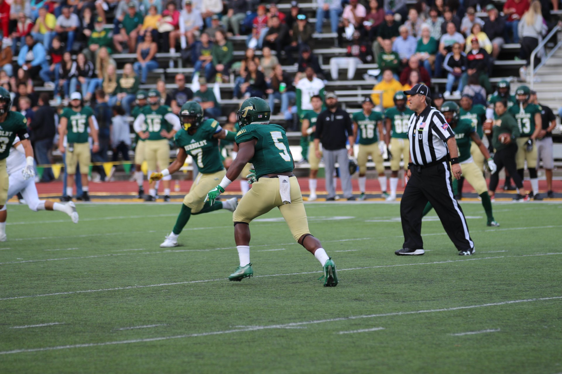 Humboldt State linebacker Demetrick Watts II in action as defense attempts to stop Western Oregon's drive down the field in a home game on September 22. | Photo by Walter Hackett