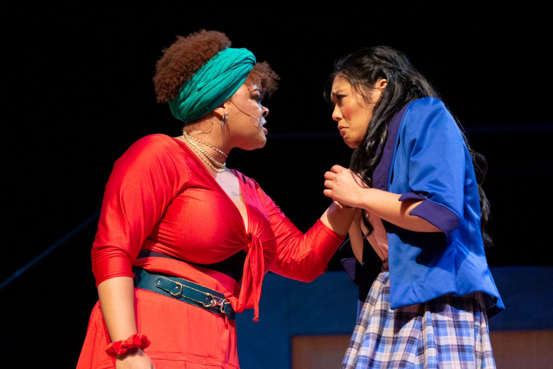 Kiara Hudlin, as Heather Chandler, grabs and threatens Gwynnevere Cristobal, as Veronica Sawyer, during a scene of