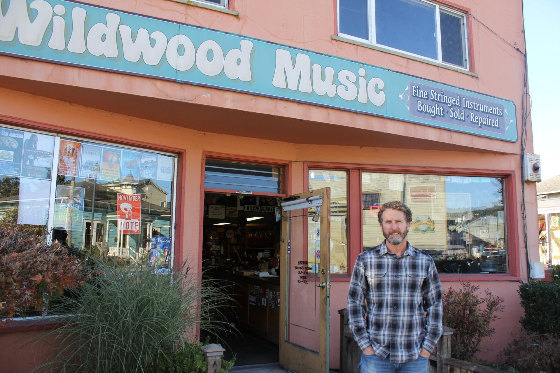 Wildwood Music Store Owner Errol Previde poses in front of the store on Nov. 5. Pervide took over the store on its 30th anniversary.