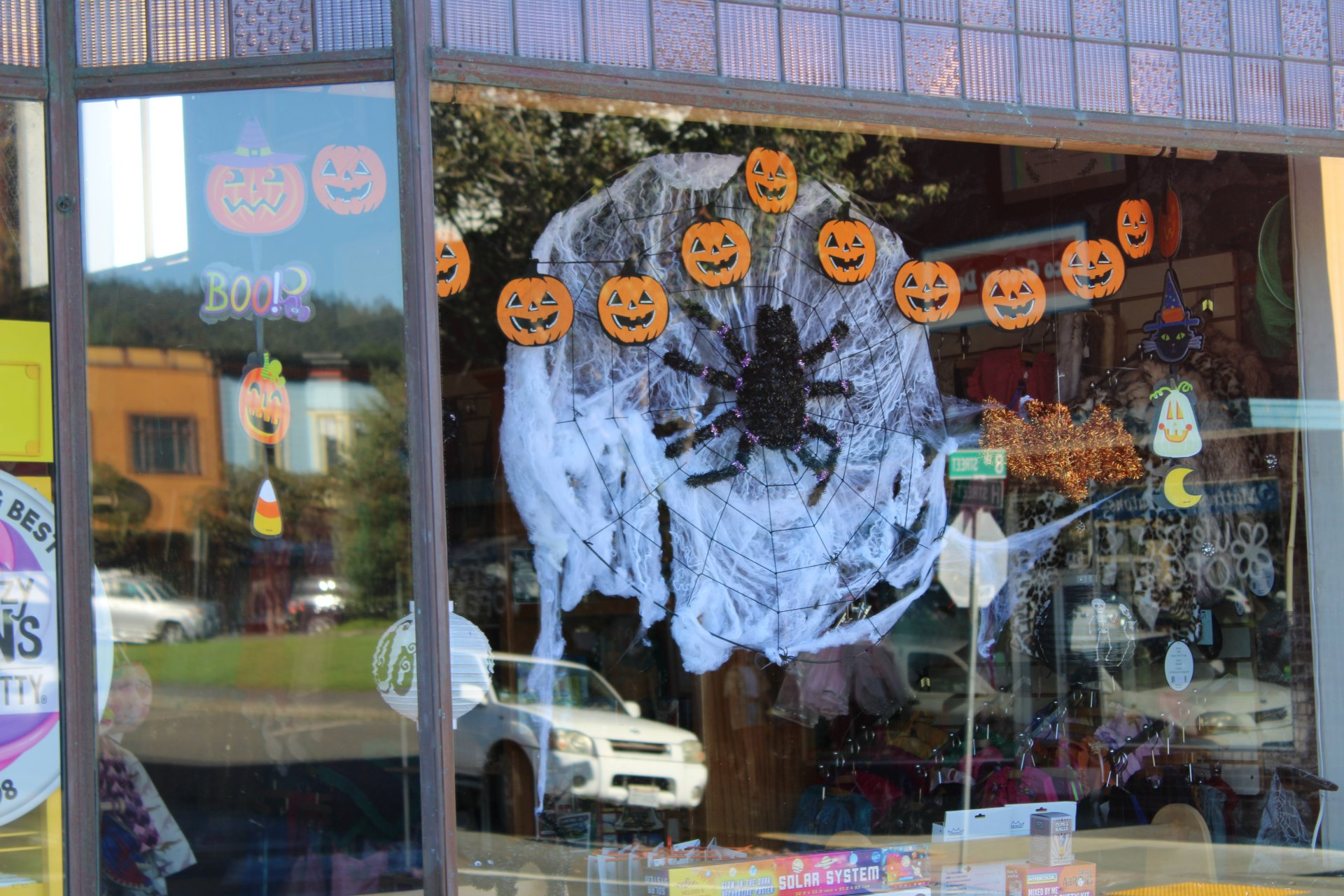 Store fronts decorated for Halloween and info flyers about upcoming spooky events on the plaza on Oct. 17th. | Photo by Becca Laurenson