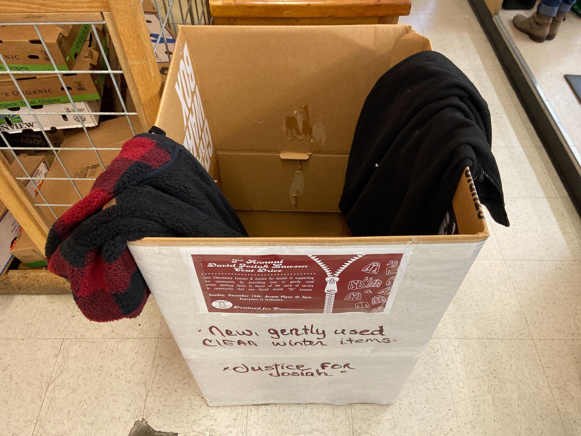 A 3rd Annual David Josiah Lawson Coat Drive drop-off box sits next to the customer service desk at Arcata's North Coast Co-Op. | Photo by Skye Kimya