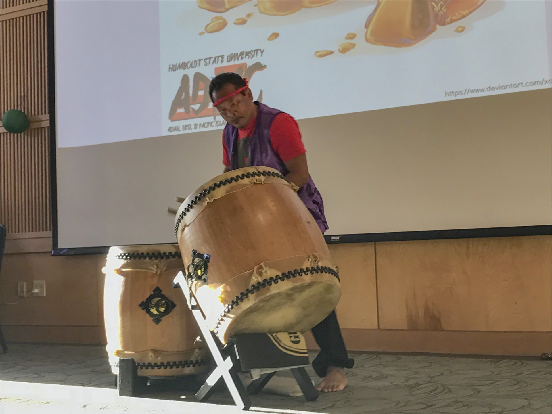 Garry Ronne performs an upbeat drum solo for guests at the Mid Autumn Festival. | Photo by Amanda Schultz