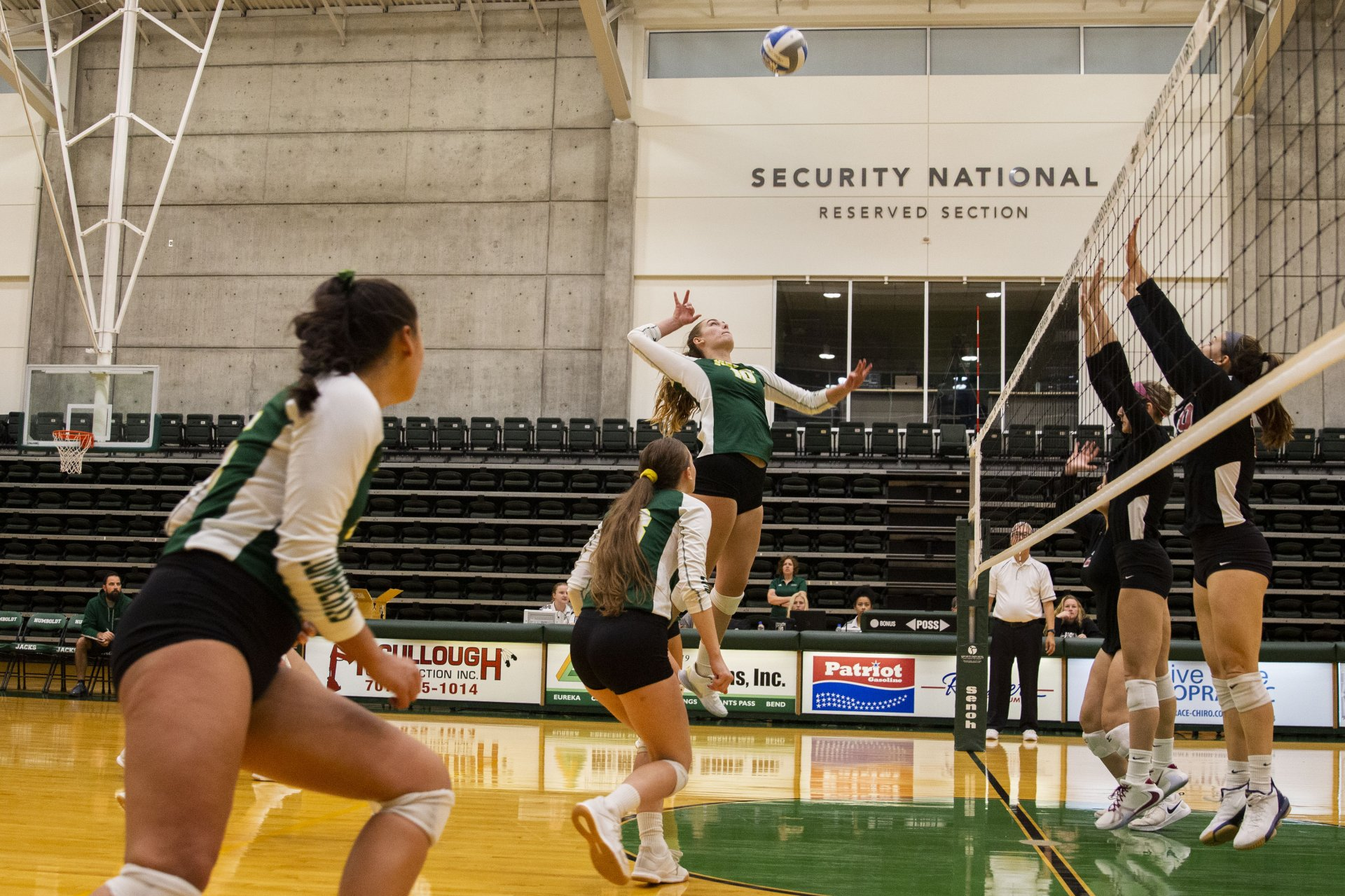 Humboldt State's Summer Hansen jumps up to hit the ball during the Jacks' match against Chico State at Lumberjack Arena on Nov. 1. | Photo by Thomas Lal