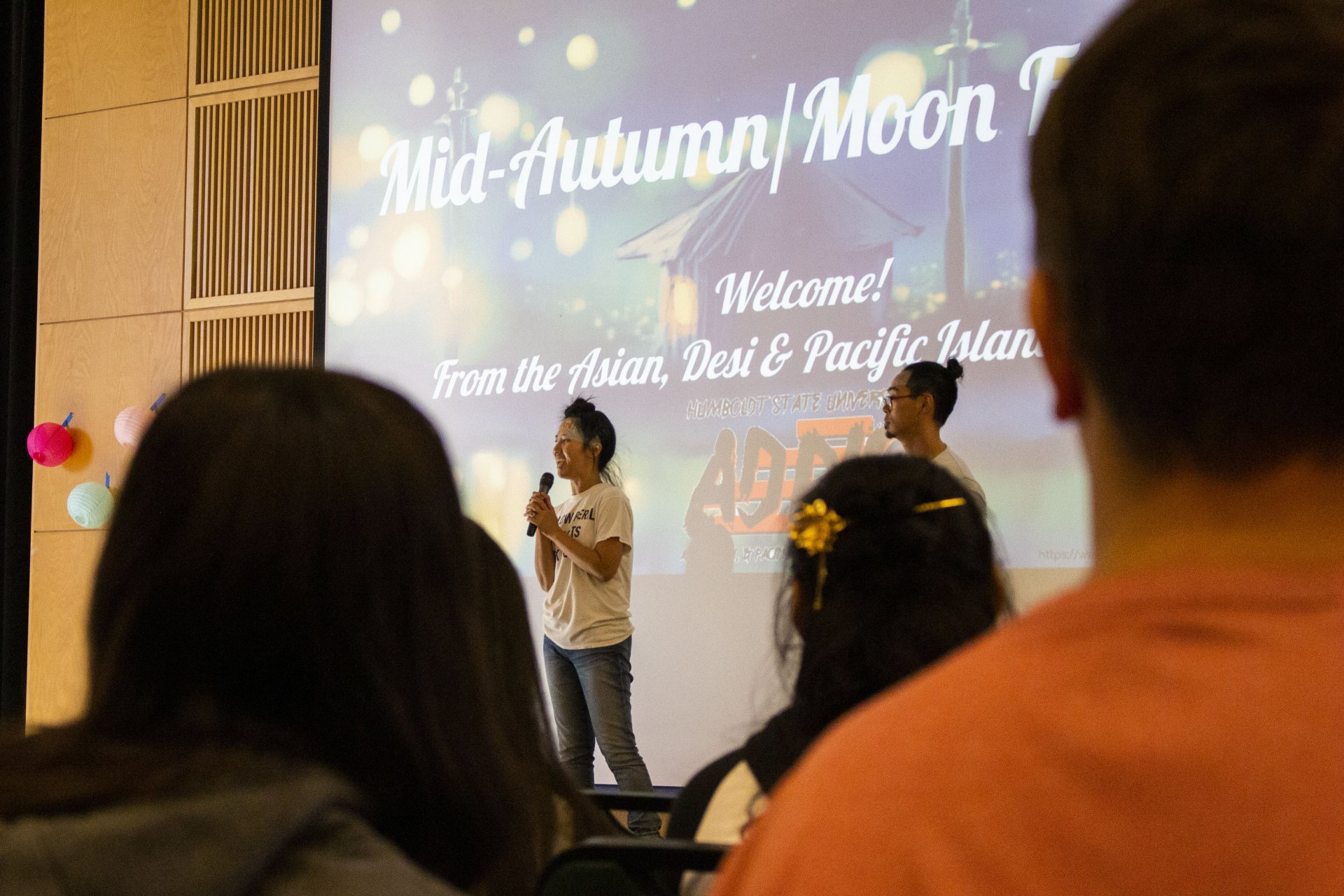 ADPIC President Tammy Phrakonkham speaks to the gathered students and community members at the Mid-Autumn Moon Festival in the Kate Buchanan Room on September 13. | Photo by Thomas Lal