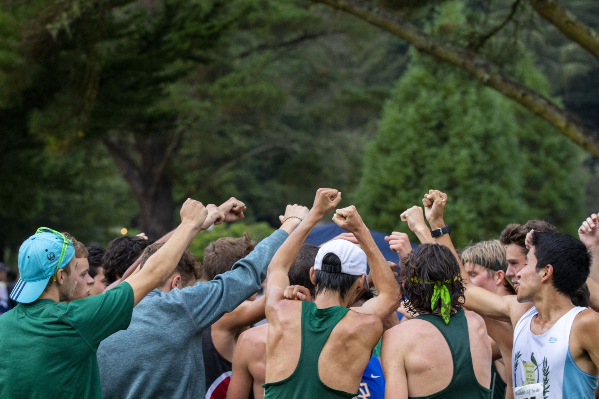 The HSU mens cross country runners raise their fists in celebration after taking both the individual and team wins at the Humboldt Invite on September 6.   Photo by Thomas Lal