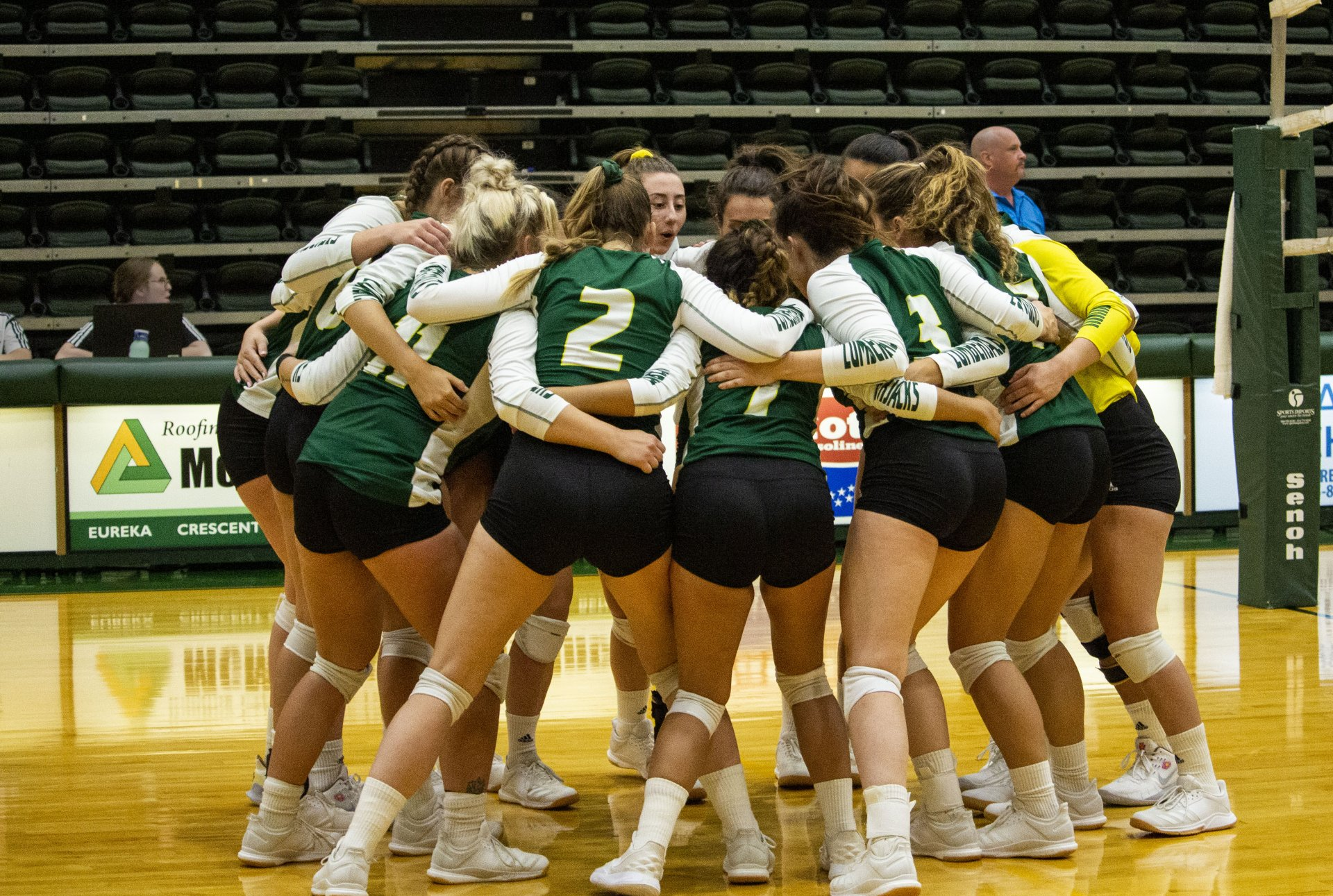 The Humboldt State volleyball team huddles together before the start of their match against Cal State Bernardino on Sept. 21 at Lumberjack Arena. | Photo by Thomas Lal