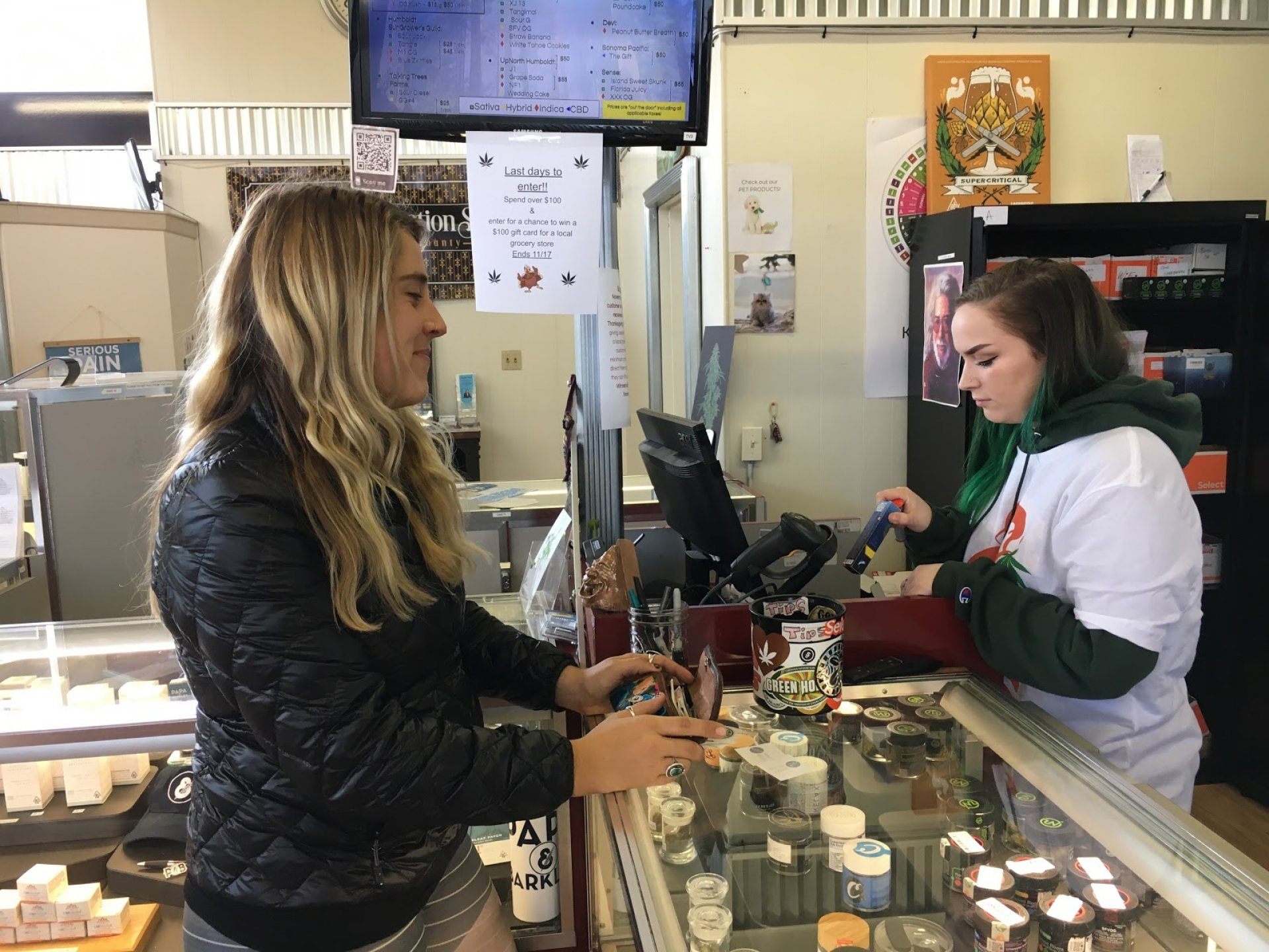 Madison White, an alcohol sober student at College of the Redwoods, makes a purchase from Humboldt State University student and floor manager Brianna Chapman on Nov. 16. | Photo by Freddy Brewster