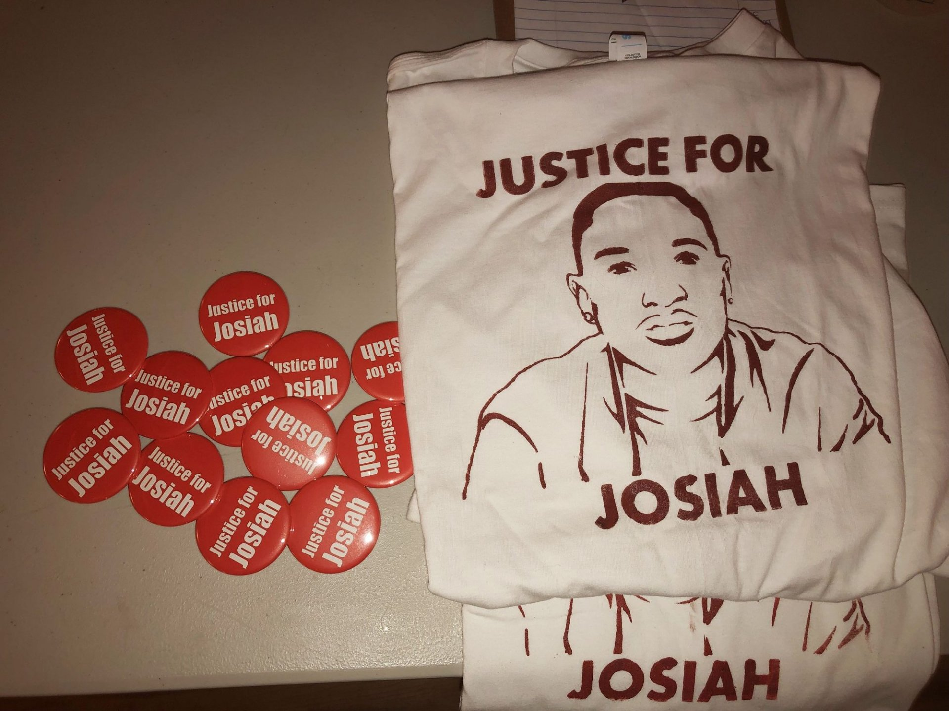 T-shirts and buttons were being sold at the vigil. | Photo by Delaney Duarte