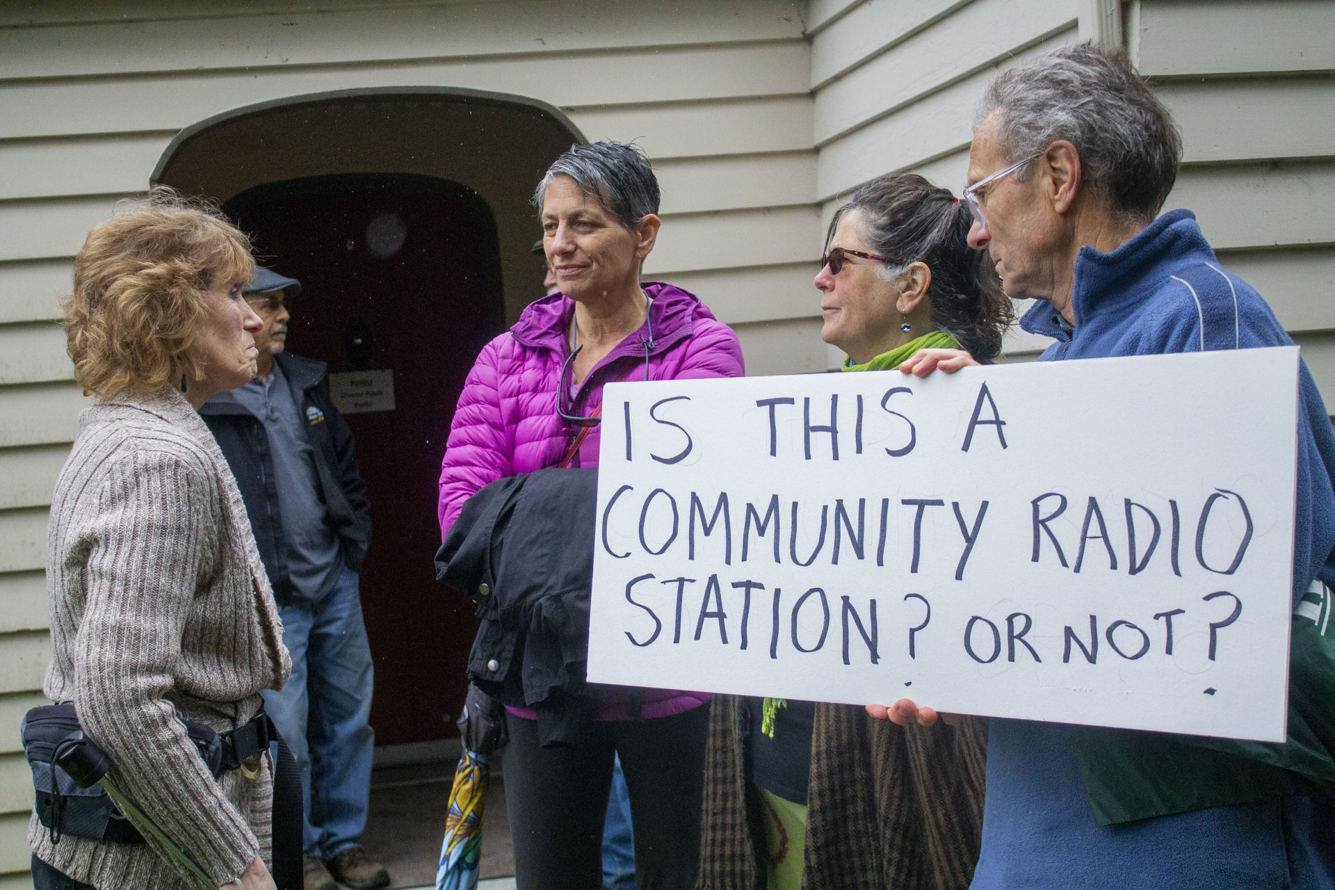 Now former volunteers and station supporters meet outside of Feuerwerker House after hearing about the elimination of jobs and volunteer positions at KHSU on April 11. | Photo by Thomas Lal