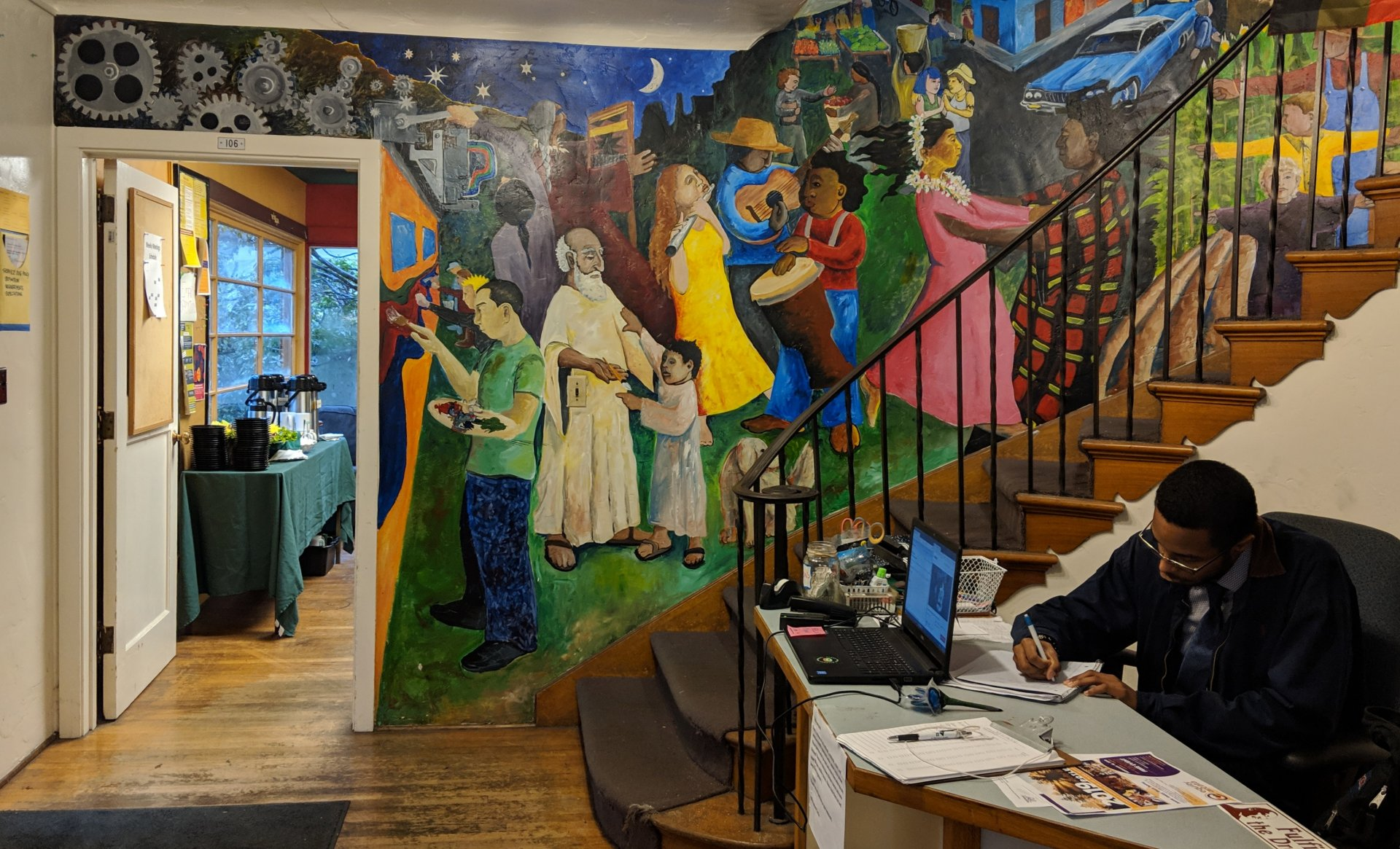 The interior of the MCC is decorated with murals depicting the diverse range of cultures that funnel into our campus. Cameron Rodriguez has been working at MCC for about a year. Photo by Jett Williams